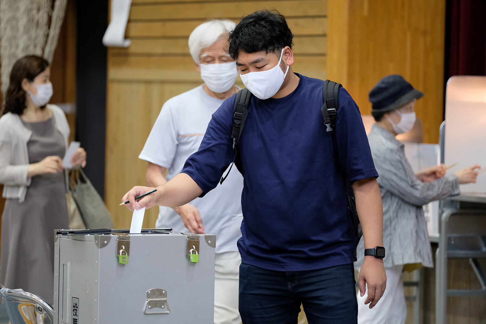 A man casts his vote for the Tokyo gubernatorial election at a polling station in Shinjuku area in Tokyo on July 5.