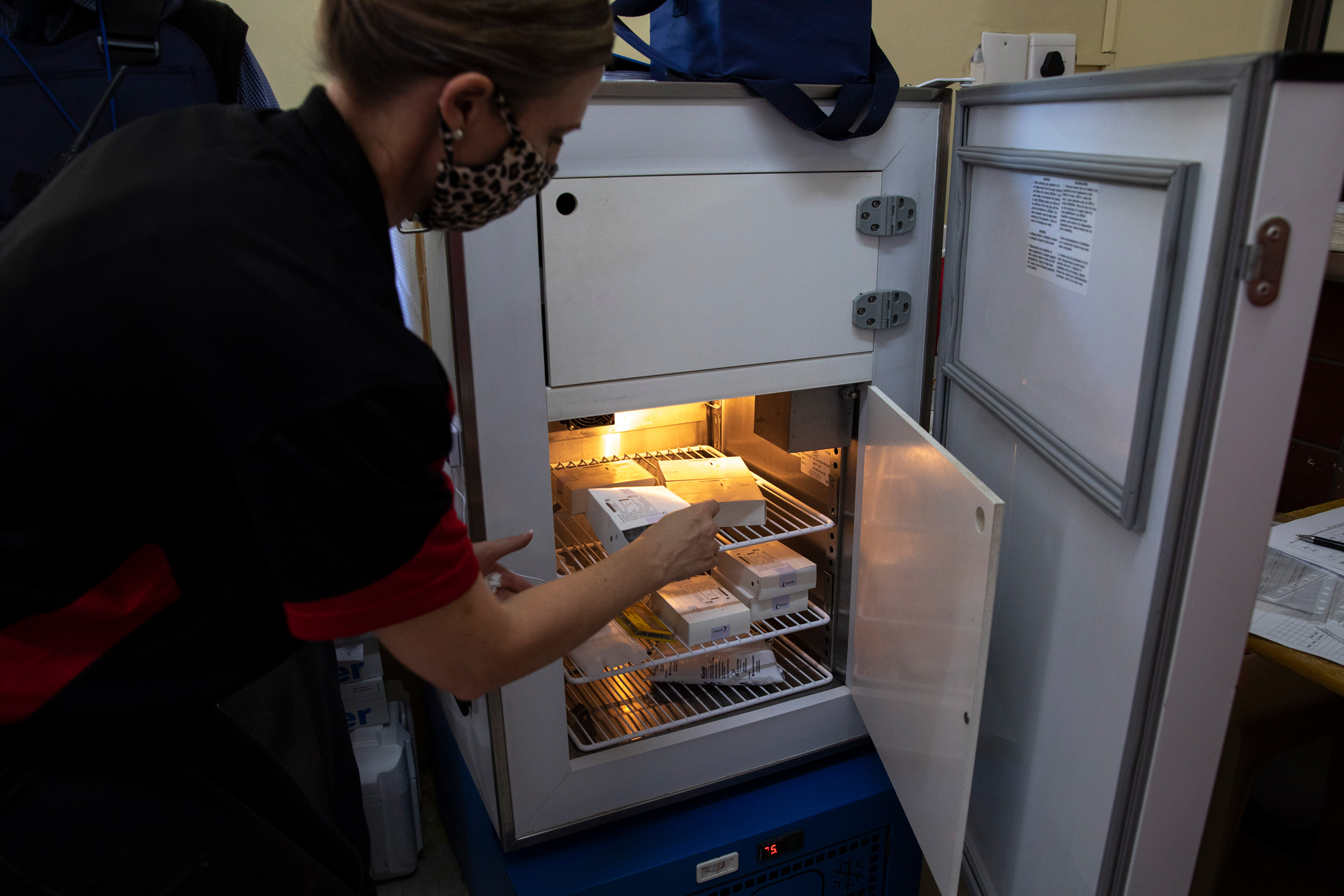A healthcare worker takes out the Johnson & Johnson COVID-19 coronavirus vaccine from a temperature controlled fridge at the Klerksdorp Hospital in South Africa on February 18.