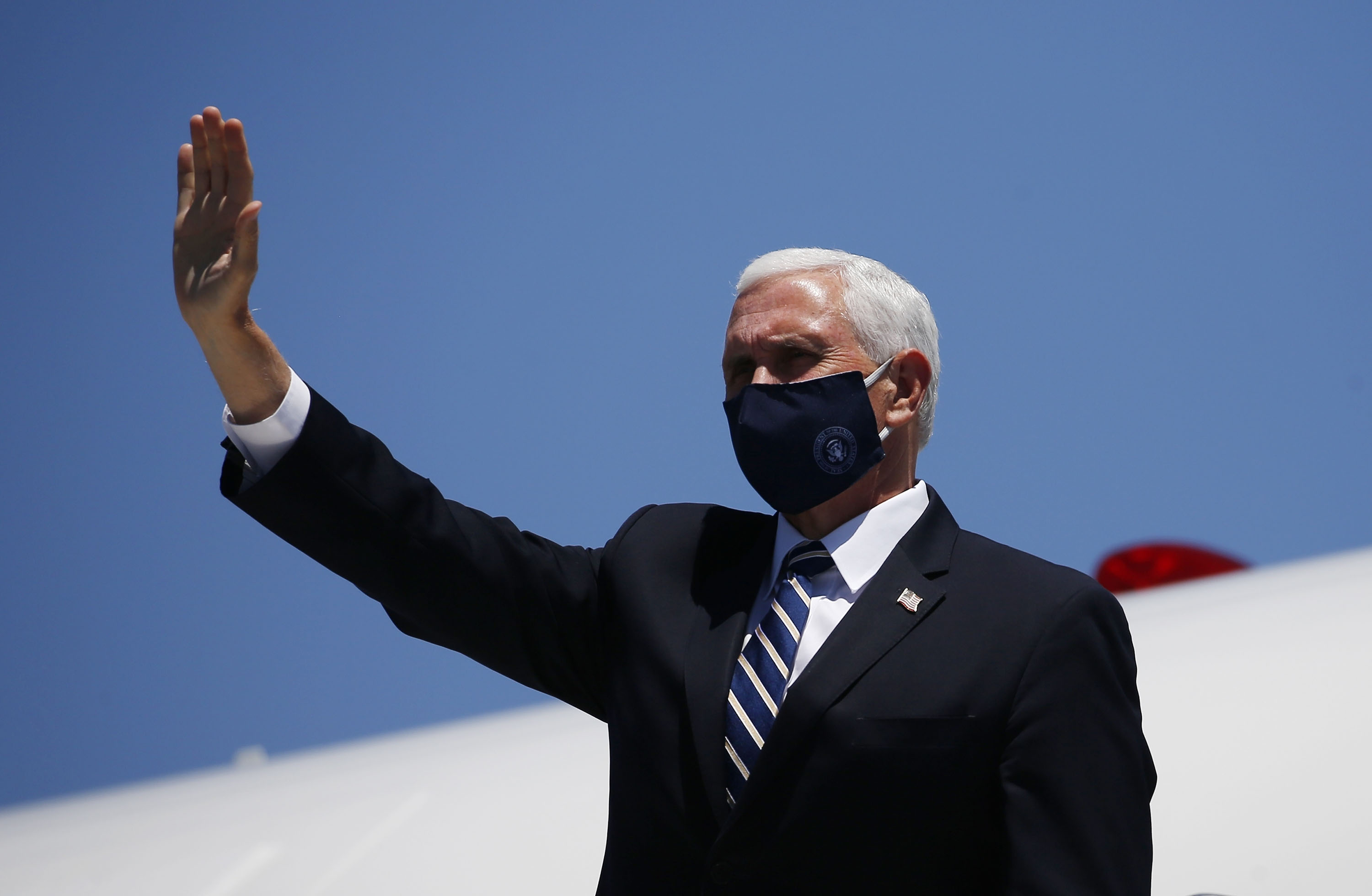Vice President Mike Pence waves as he arrives in Phoenix to meet with Arizona Republican Gov. Doug Ducey to discuss the surge in coronavirus cases on Wednesday, July 1.