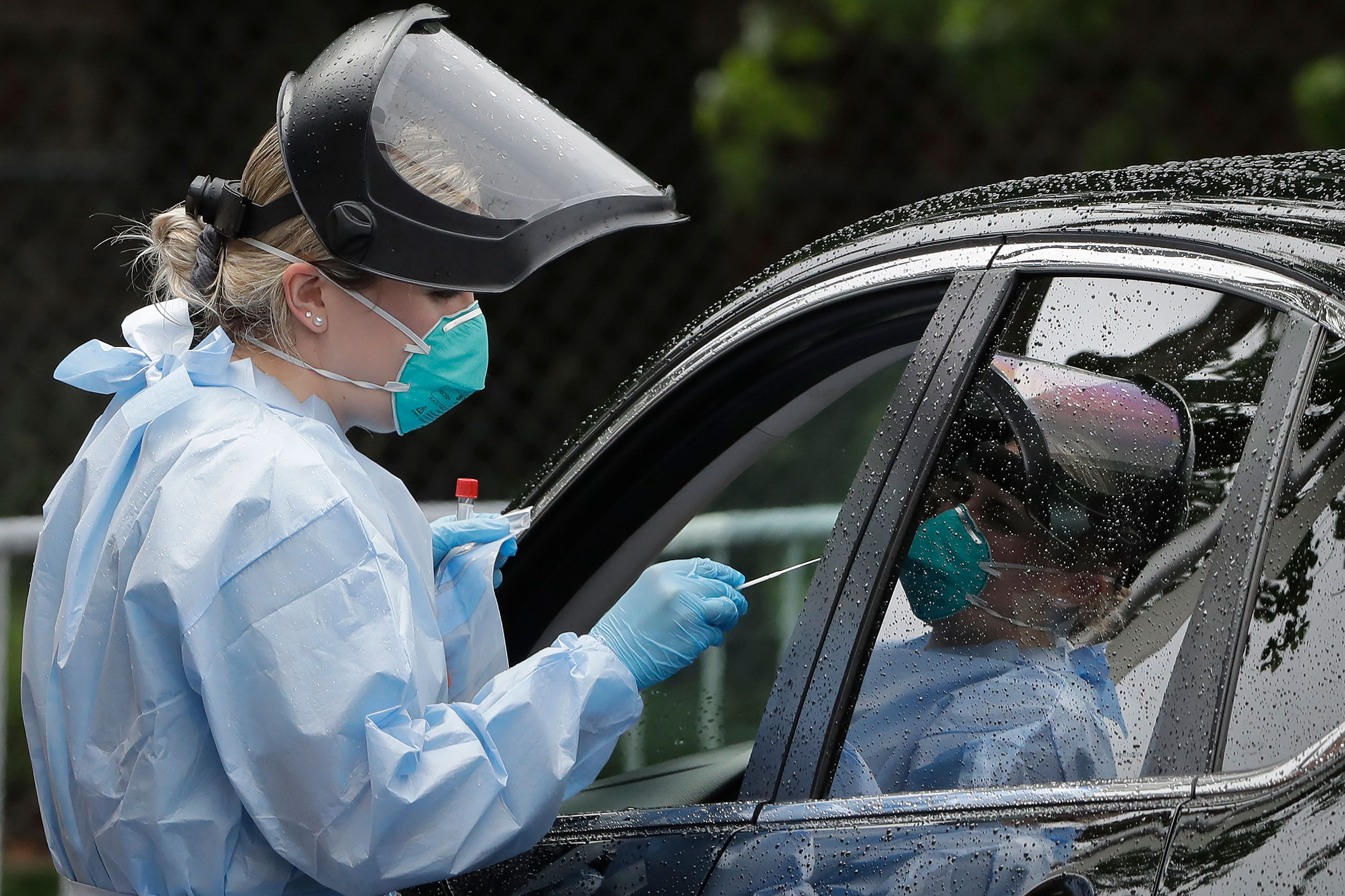 A medical worker administer a coronavirus test on June 11 in Boston.