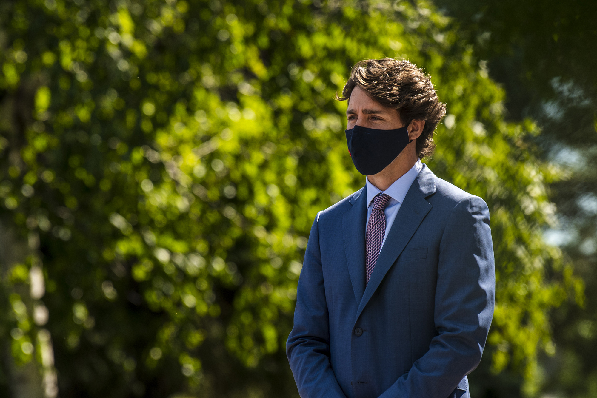 Justin Trudeau, Canada's prime minister, waits to speak at the National Research Council of Canada Royalmount Human Health Therapeutics Research Centre facility in Montreal on Monday, Aug. 31.