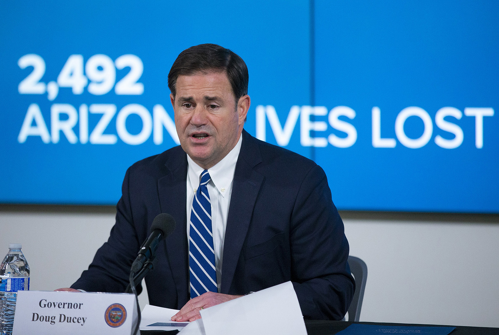 Arizona Gov. Doug Ducey takes questions from reporters during a COVID-19 press conference on Thursday, July 16, in Phoenix.