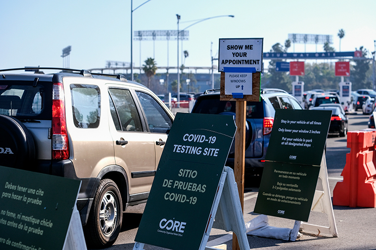 Motorists wait in long lines to take a coronavirus test in a parking lot at Dodger Stadium on Monday, January. 4, in Los Angeles.