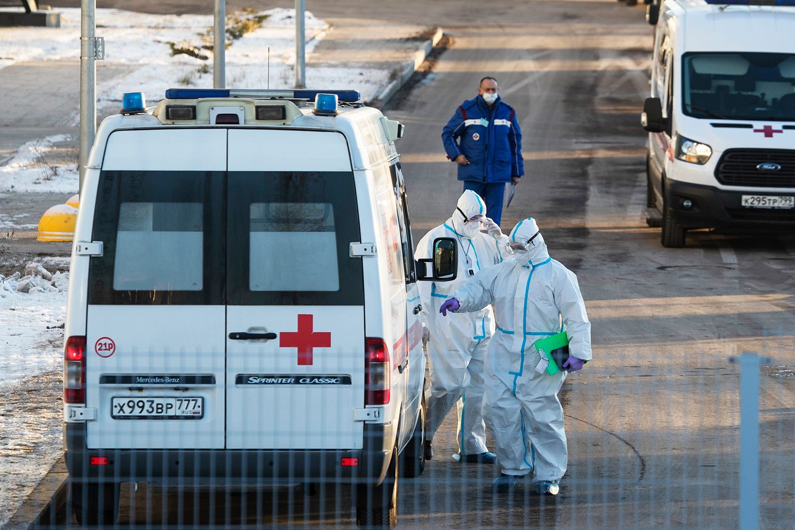 Medical workers wearing protective gear return to their ambulance after transferring a patient suspected of having Covid-19 at a hospital in Kommunarka, outside Moscow, on December 5.