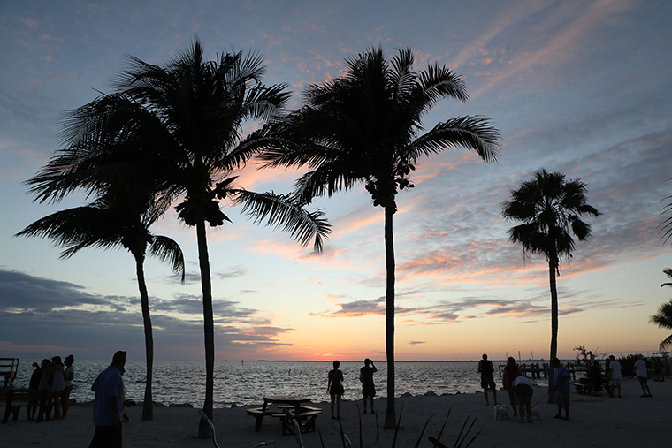 People watch the sunset in the Florida keys from Sunset Park on November 24 2019, in Marathon Island, Florida.