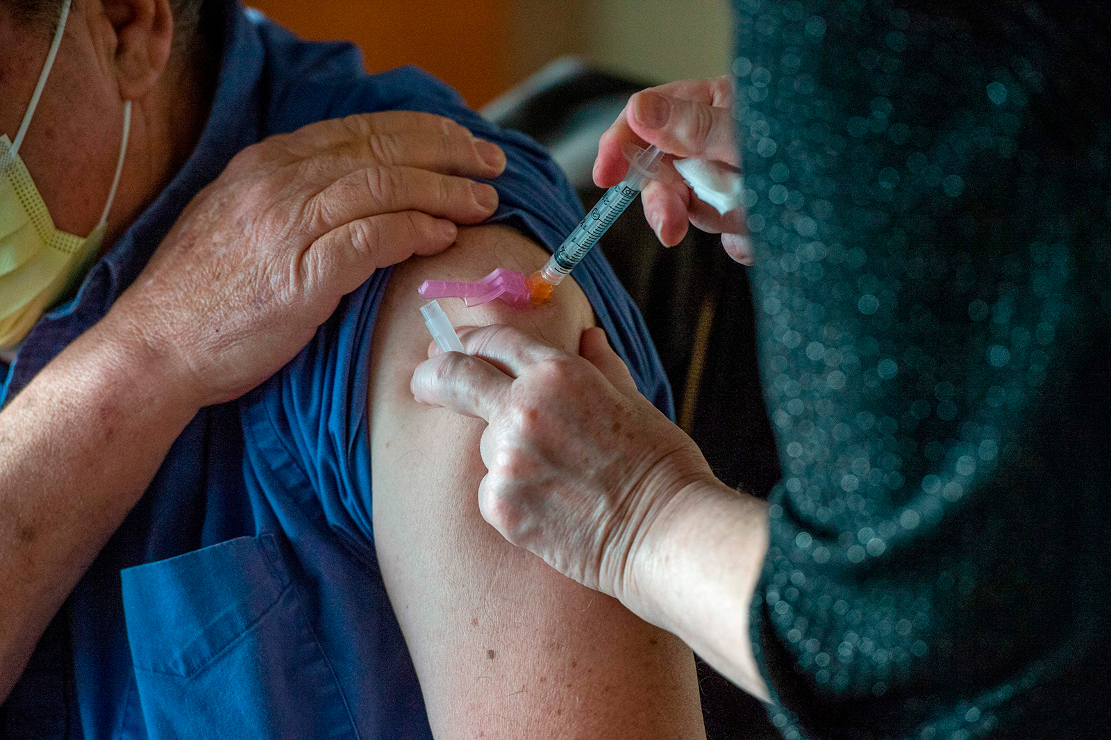 A person receives the Moderna Covid-19 vaccine at the East Boston Neighborhood Health Center (EBNHC) in Boston, Massachusetts, on December 24, 2020.
