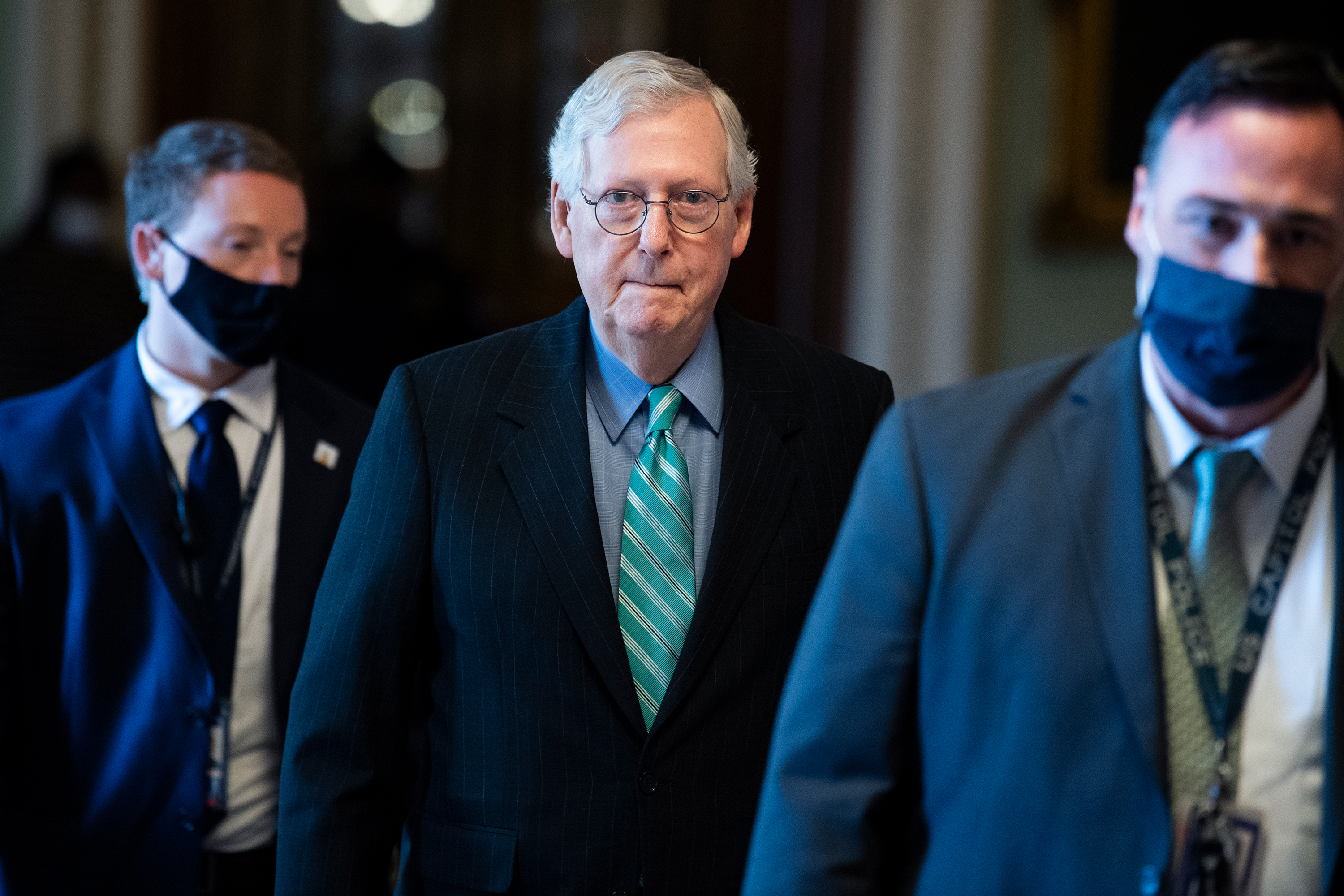 Senate Minority Leader Mitch McConnell walks in the US Capitol on Thursday, October 7.