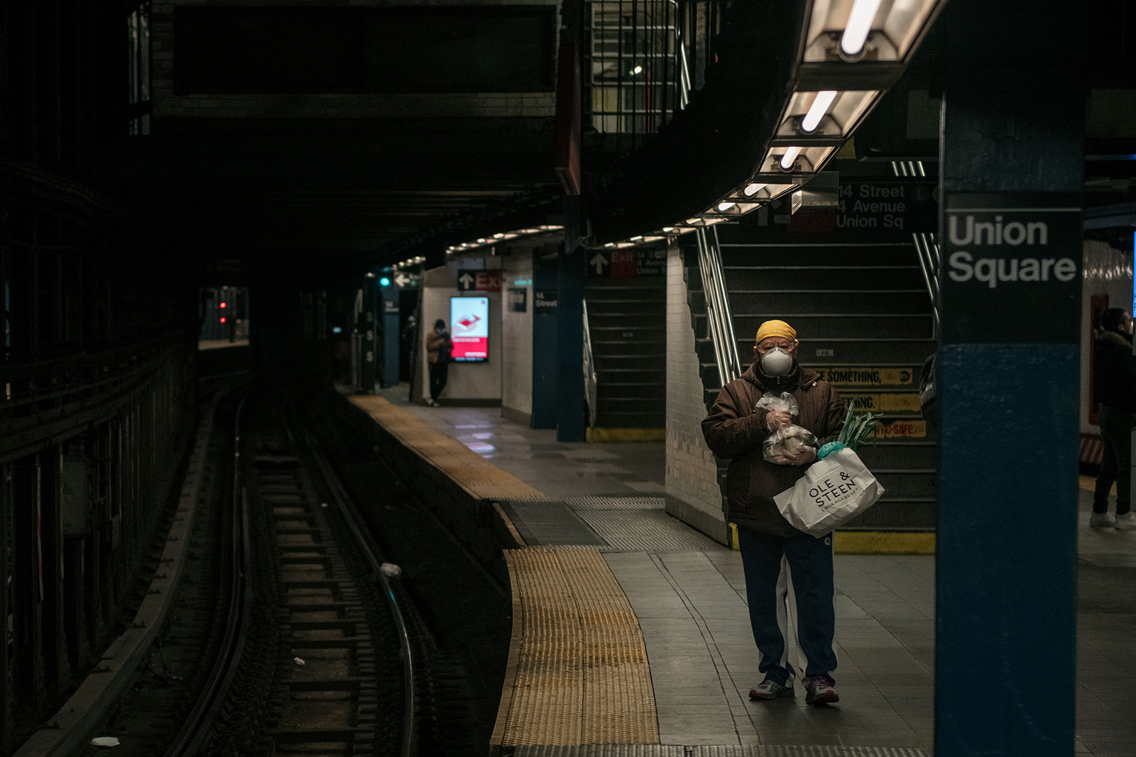A person waits for the train at a subway station in New York City on April 17.