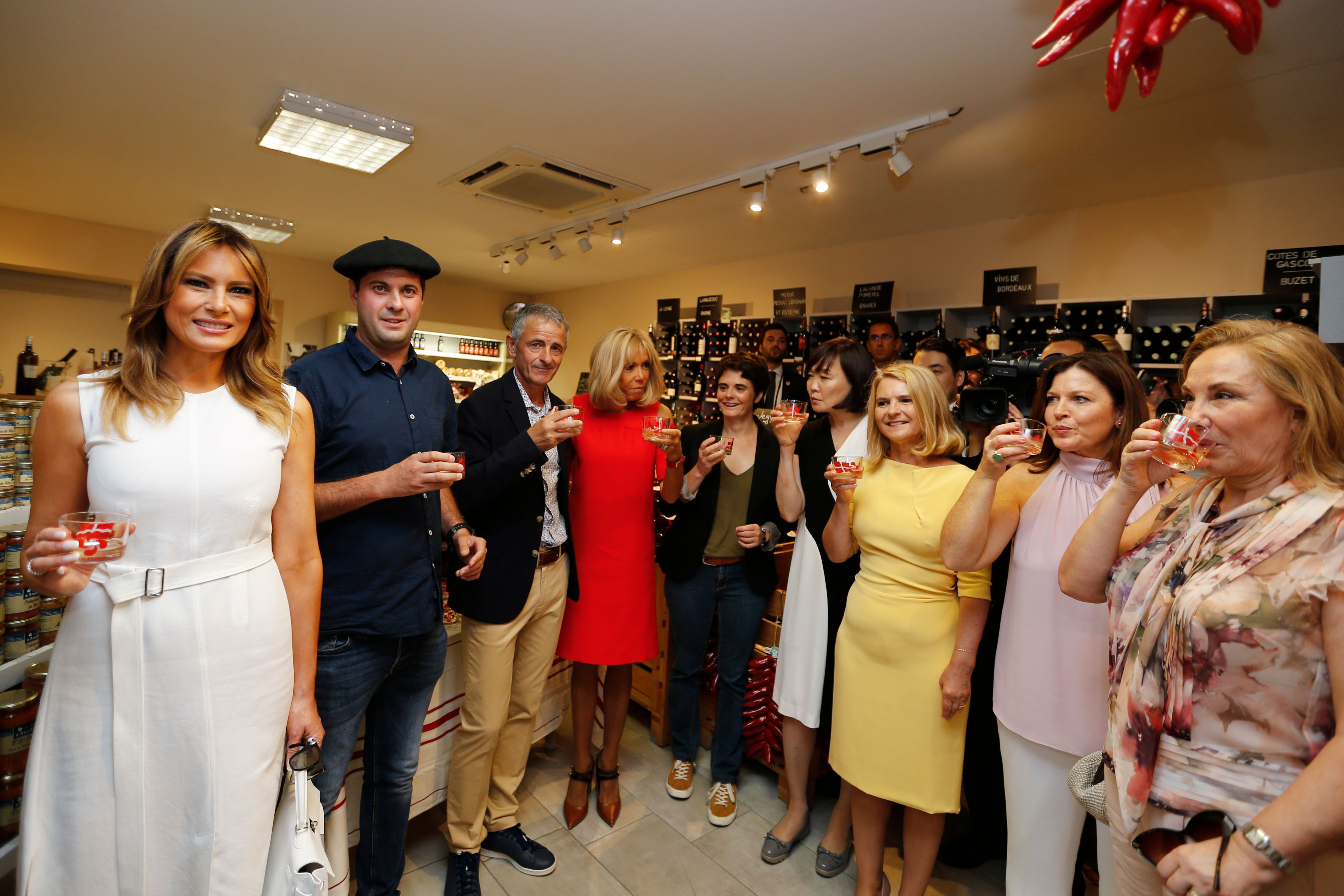 US first lady Melania Trump (l.), taste wine in a wine shop during a visit on traditional Basque culture as part of the G7 summit.