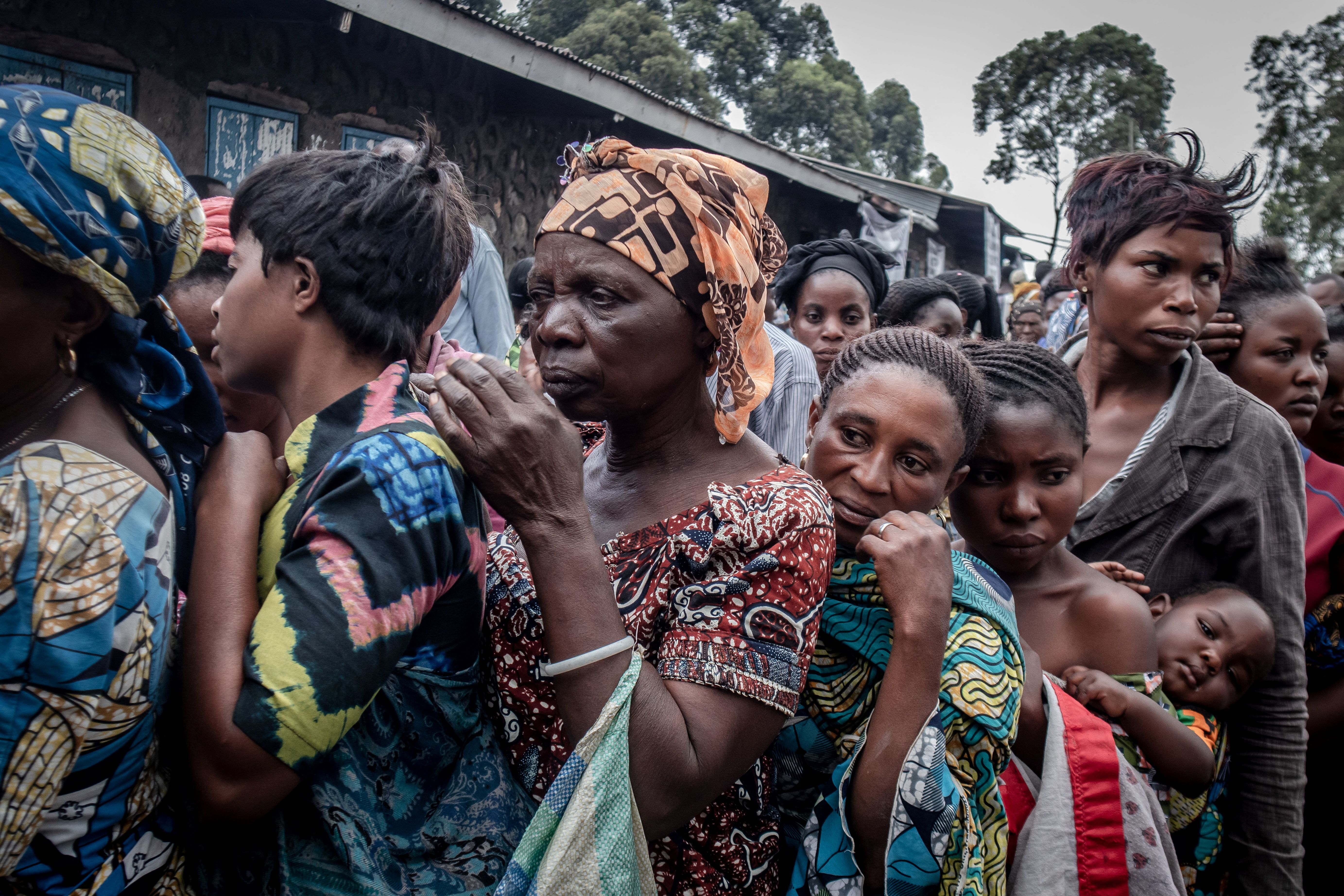 Residents displaced by the Saturday, May 22, Mount Nyiragongo volcanic eruption wait to register to receive some aid distributed by a local politician and businessman in Goma on Wednesday, May 26.