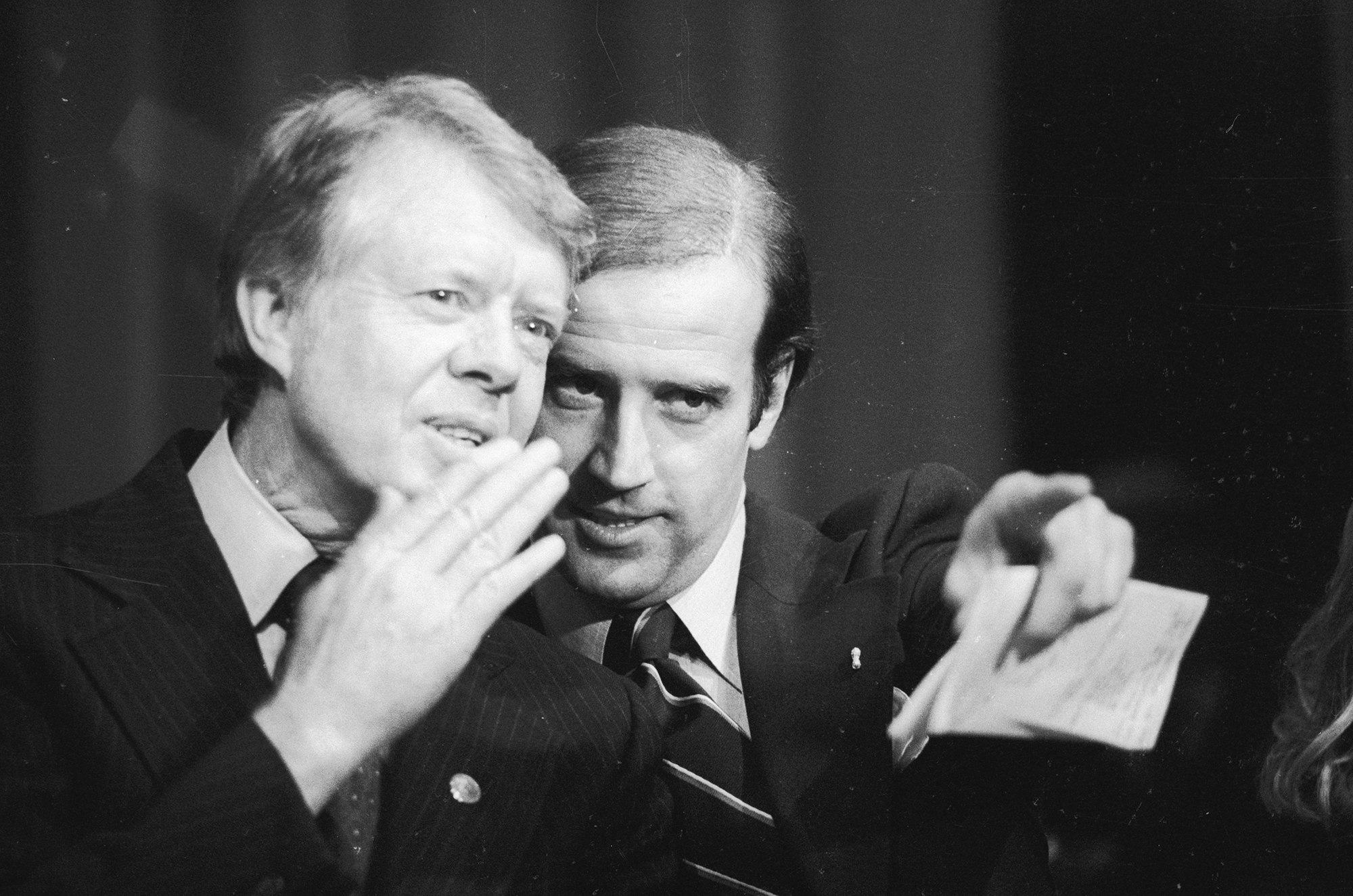 Delaware's U.S. Senator Joseph Biden points out a friend in the crowd at the Padua Academy to President Jimmy Carter during a fundraiser on February 20, 1978.