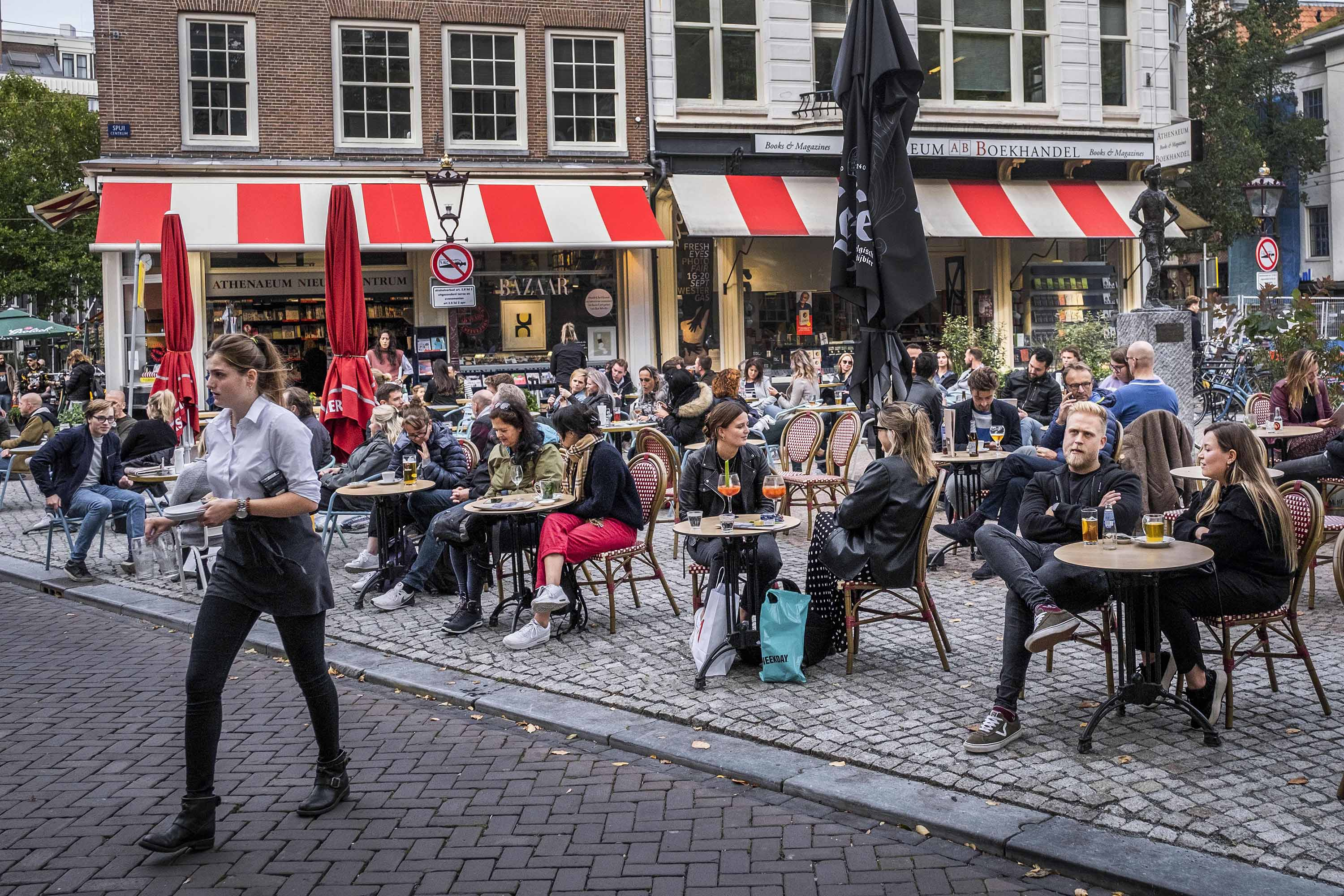People sit at cafe terrace in Amsterdam, The Netherlands, on September 26.
