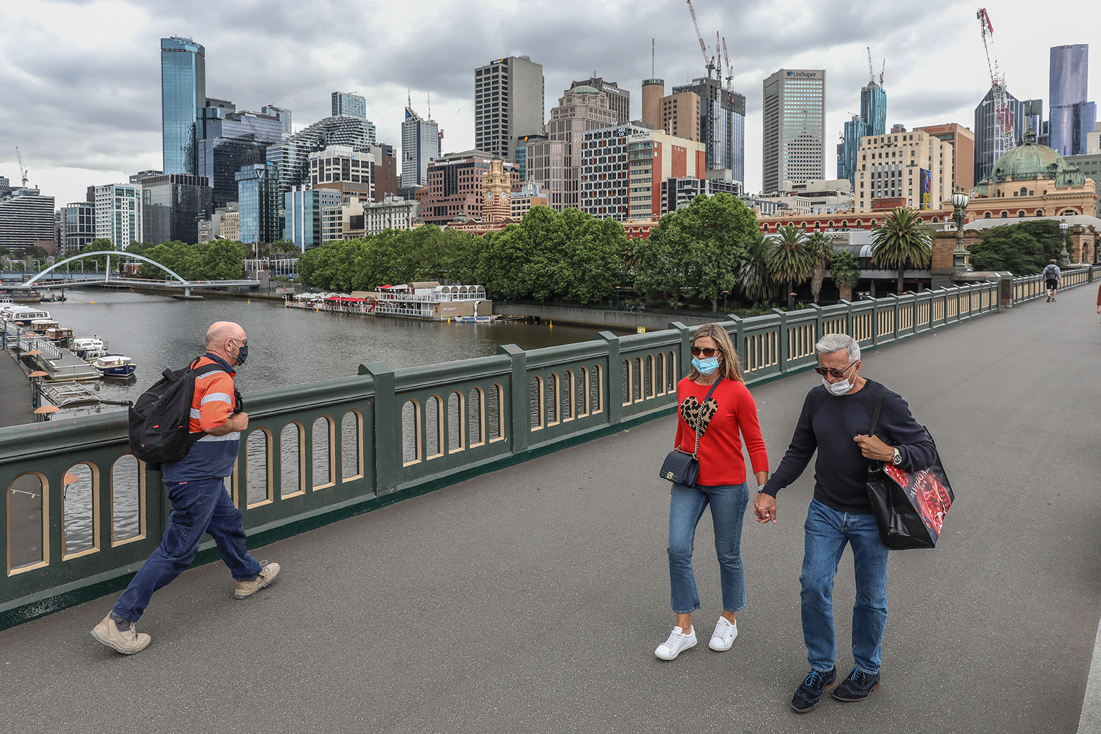A general view of pedestrians crossing the bridge with the Yarra River and CBD in the background in Melbourne, Australia, on November 06.