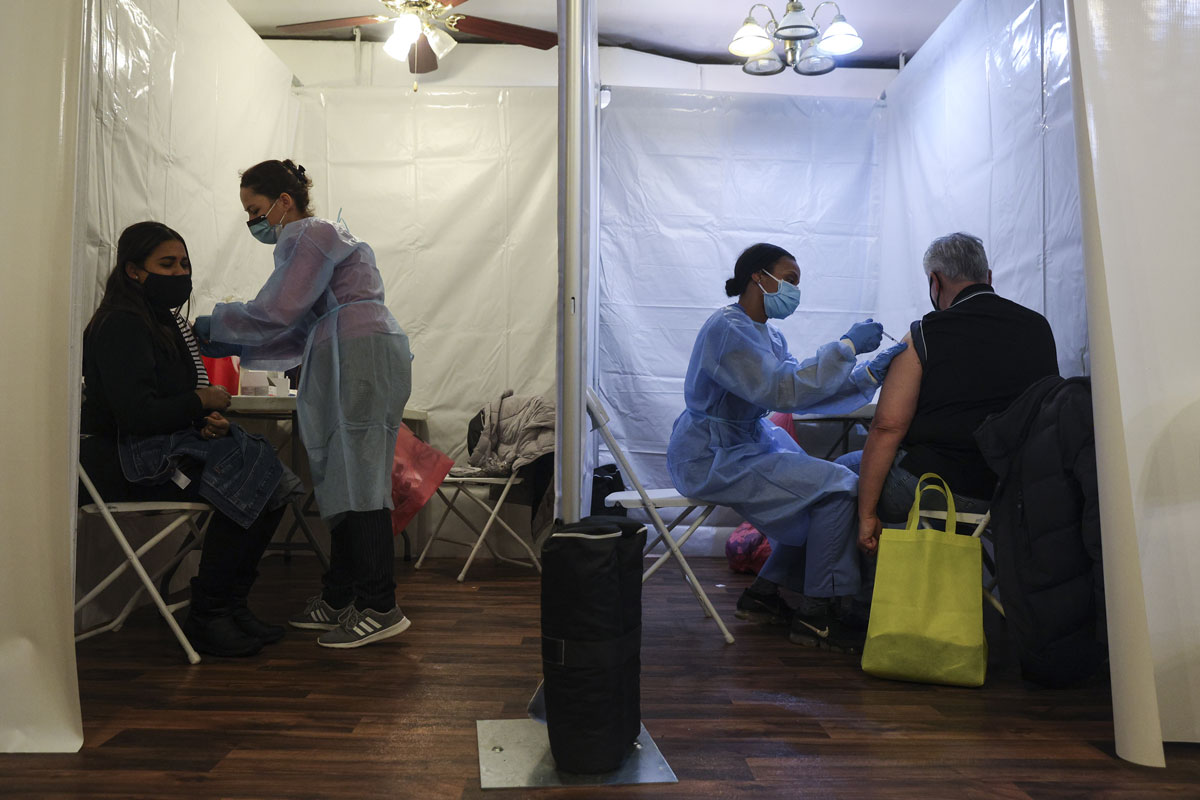 Healthcare workers administer Pfizer-BioNTech Covid-19 vaccines at a vaccination site in the Bronx borough of New York on February 5.