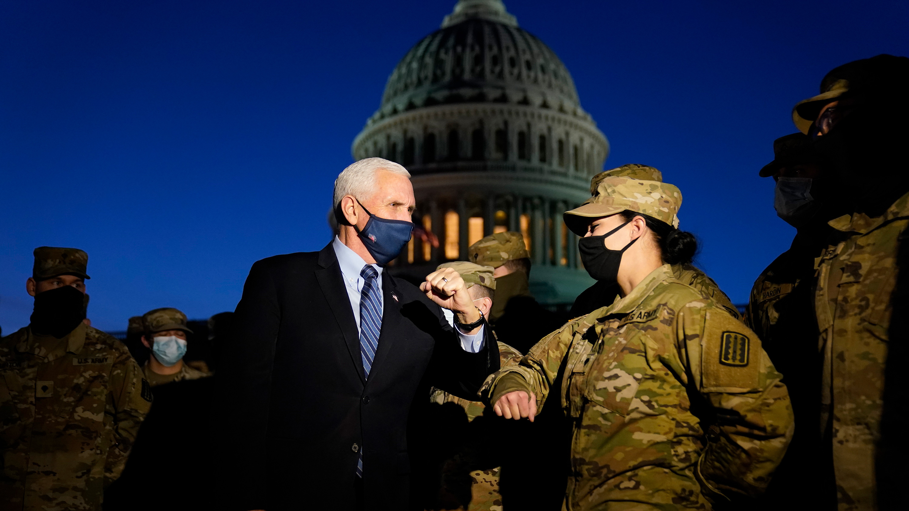 Vice President Mike Pence visits with National Guard members outside the US Capitol on Thursday, January 14 in Washington, DC.