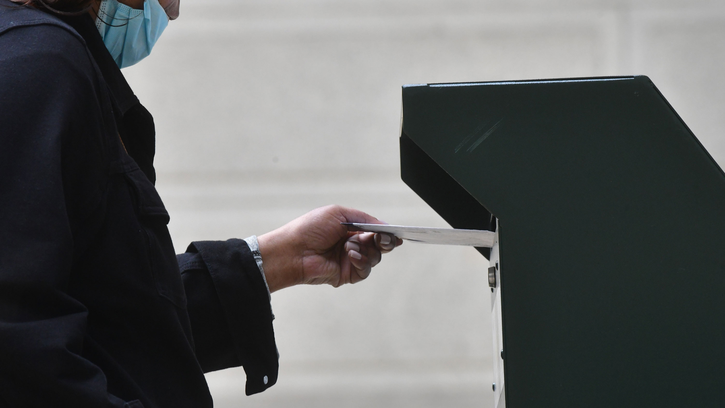 A woman deposits her ballot in an official ballot drop box on October 27 in Philadelphia, Pennsylvania.