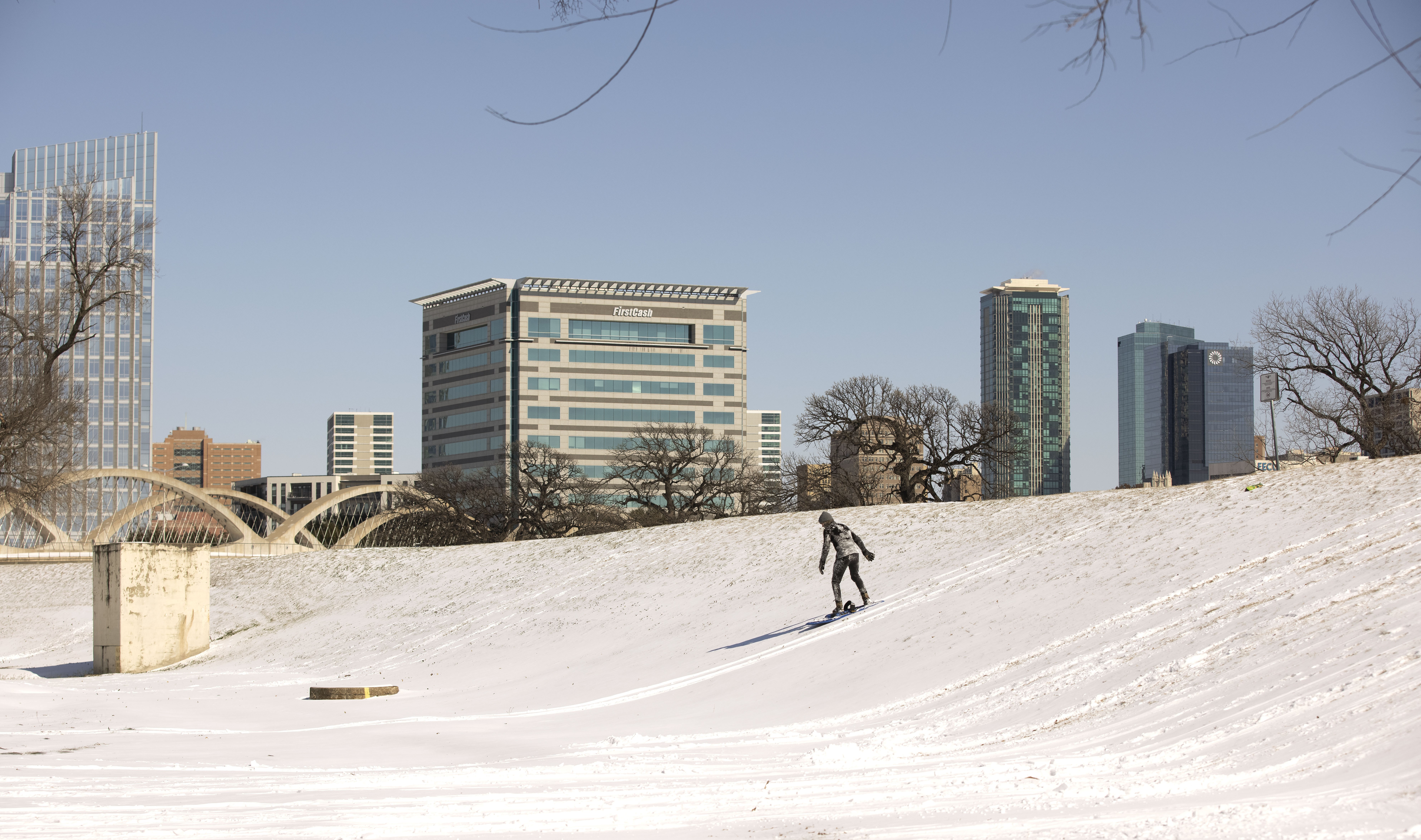 Eric Czarnecki goes sledding after a snow storm Monday in Fort Worth, Texas.