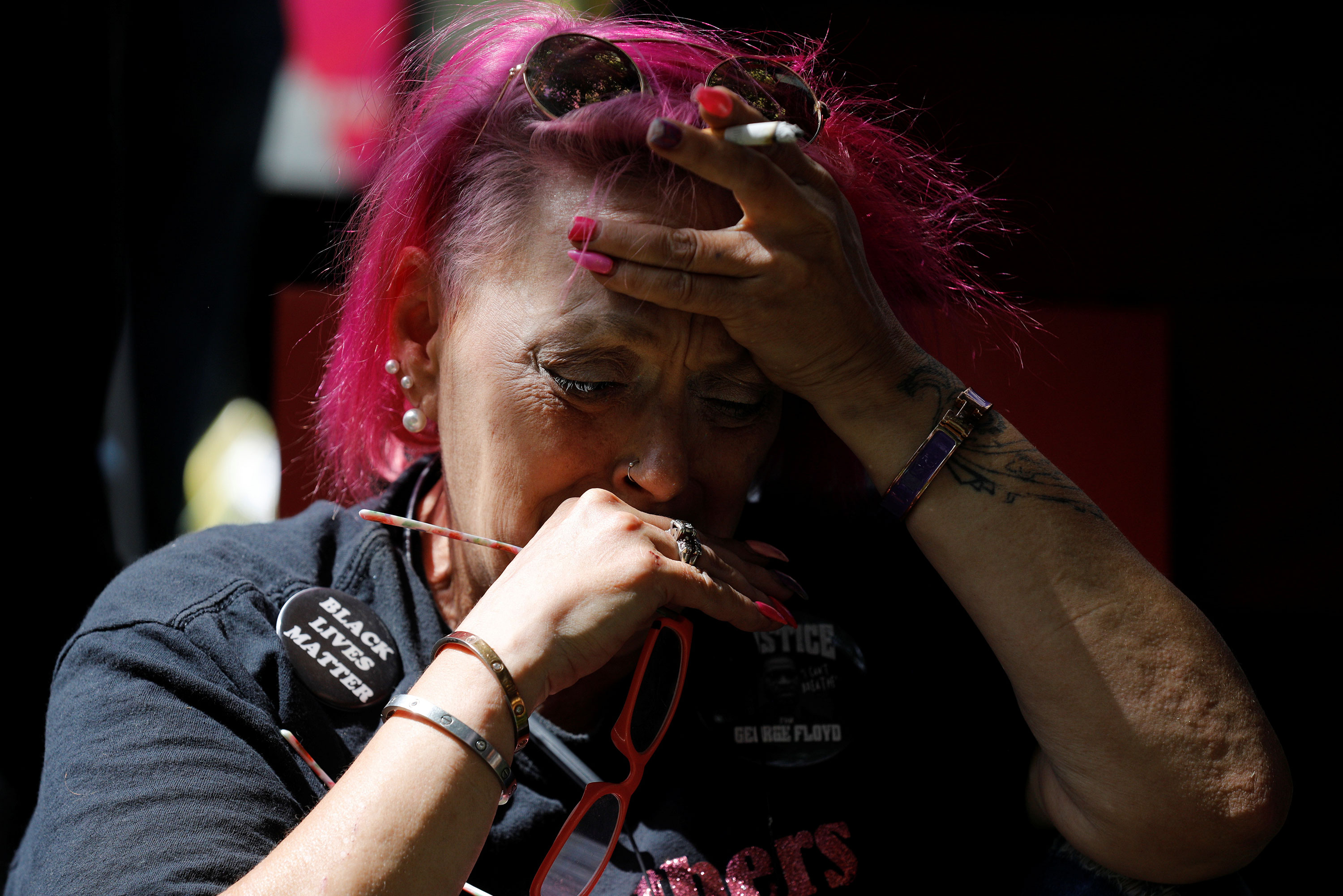 A person reacts outside Hennepin County Government Center in Minneapolis after Chauvin's sentencing.