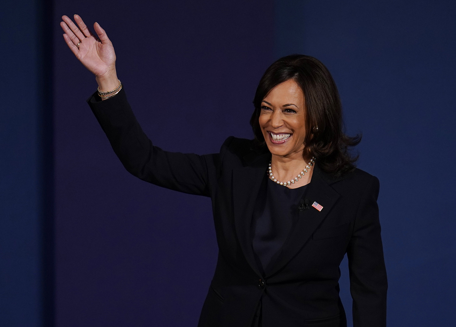 Democratic vice presidential candidate Sen. Kamala Harris waves as she arrives on stage for the vice presidential debate with Vice President Mike Pence on Wednesday, Oct. 7, at Kingsbury Hall on the campus of the University of Utah in Salt Lake City.