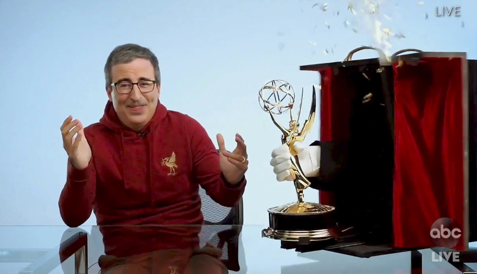 "In this video grab captured on Sept. 20, 2020, courtesy of the Academy of Television Arts & Sciences and ABC Entertainment, John Oliver accepts the award for outstanding variety talk series for ""Last Week Tonight with John Oliver"" during the 72nd Emmy Awards broadcast."