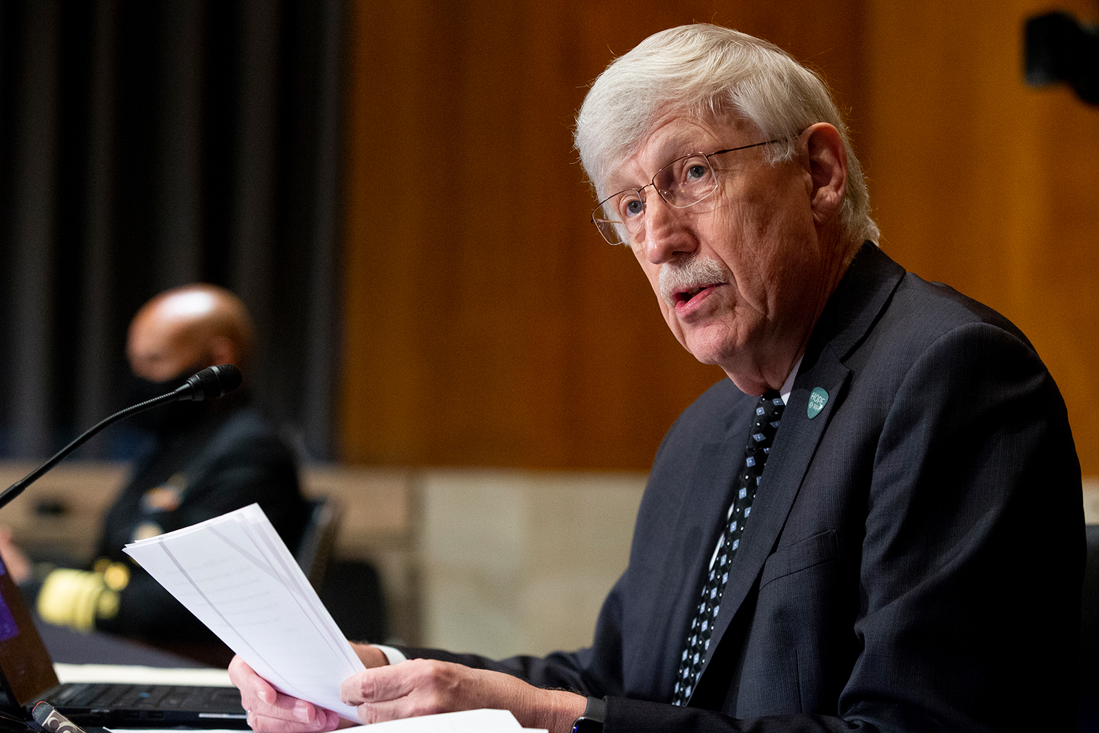 Dr. Francis Collins listens during a Senate Health, Education, Labor, and Pensions Committee hearing to discuss vaccines and protecting public health during the coronavirus pandemic in Washington DC, on Sept. 9.