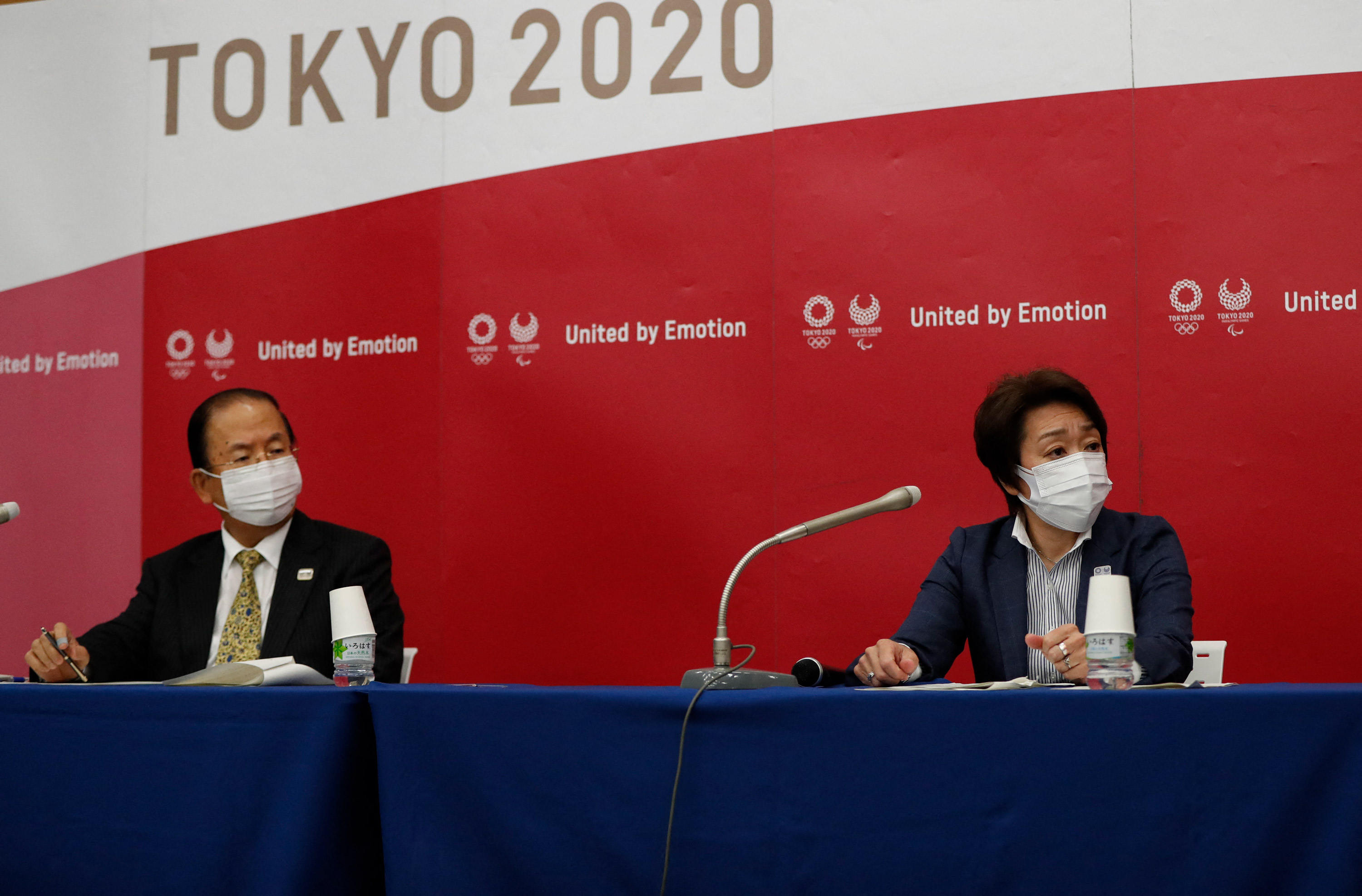 Tokyo 2020 Olympics Organising Committee president Seiko Hashimoto, right, and CEO Toshiro Muto attend a news conference in Tokyo on June 23.