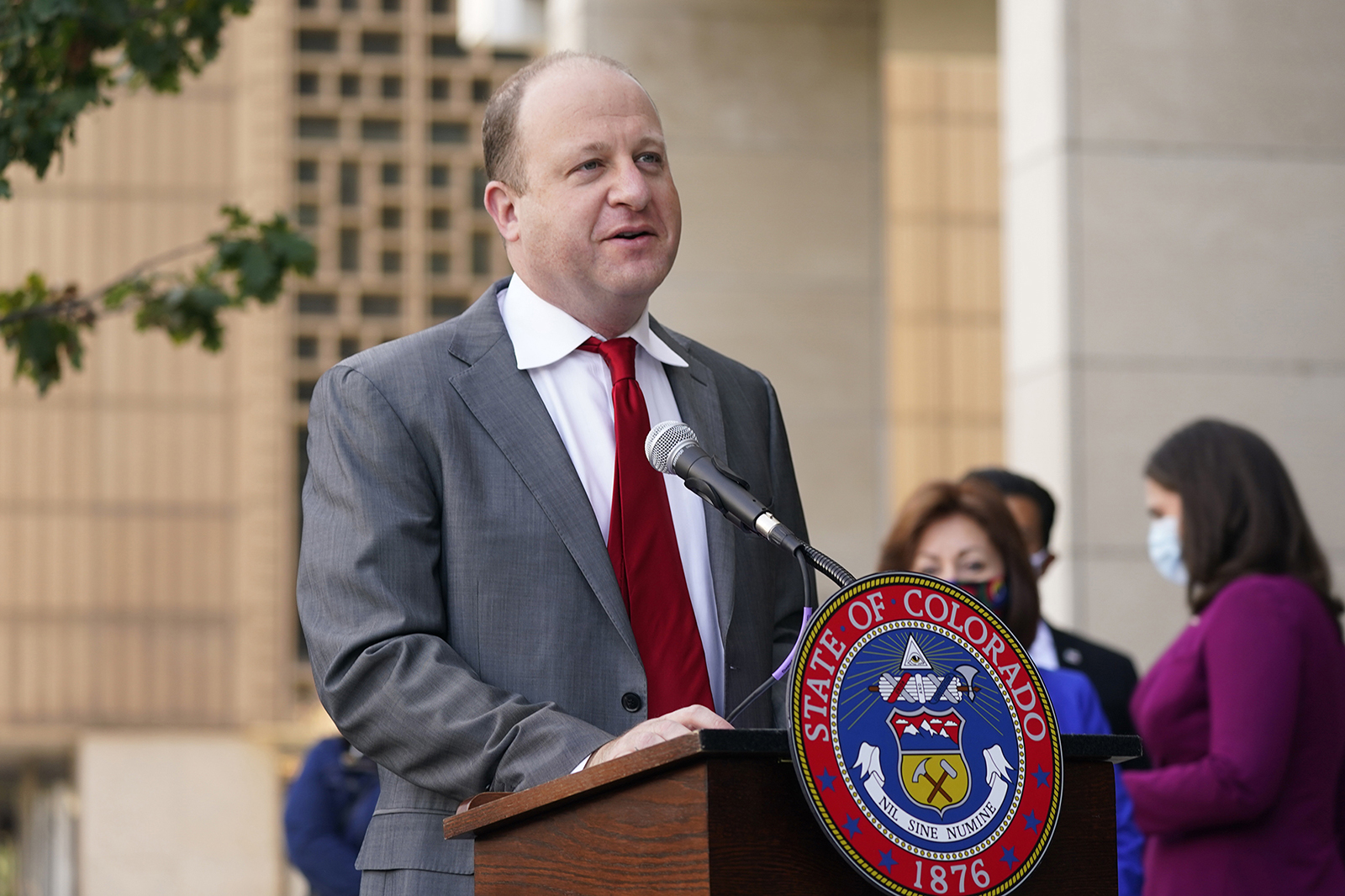Colorado Governor Jared Polis speaks during a news conference about the the state's efforts to protect the process of casting a vote in the upcoming general election Thursday, Oct. 15, in downtown Denver.
