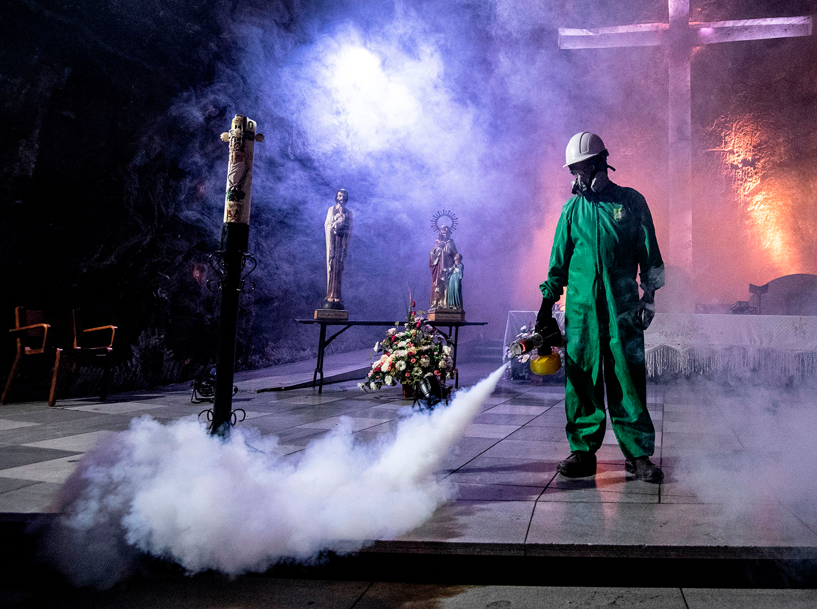A worker disinfects the Salt Cathedral of Zipaquira, an underground church built into a salt mine, in Zipaquira, 45 km north of Bogota, on August 30.