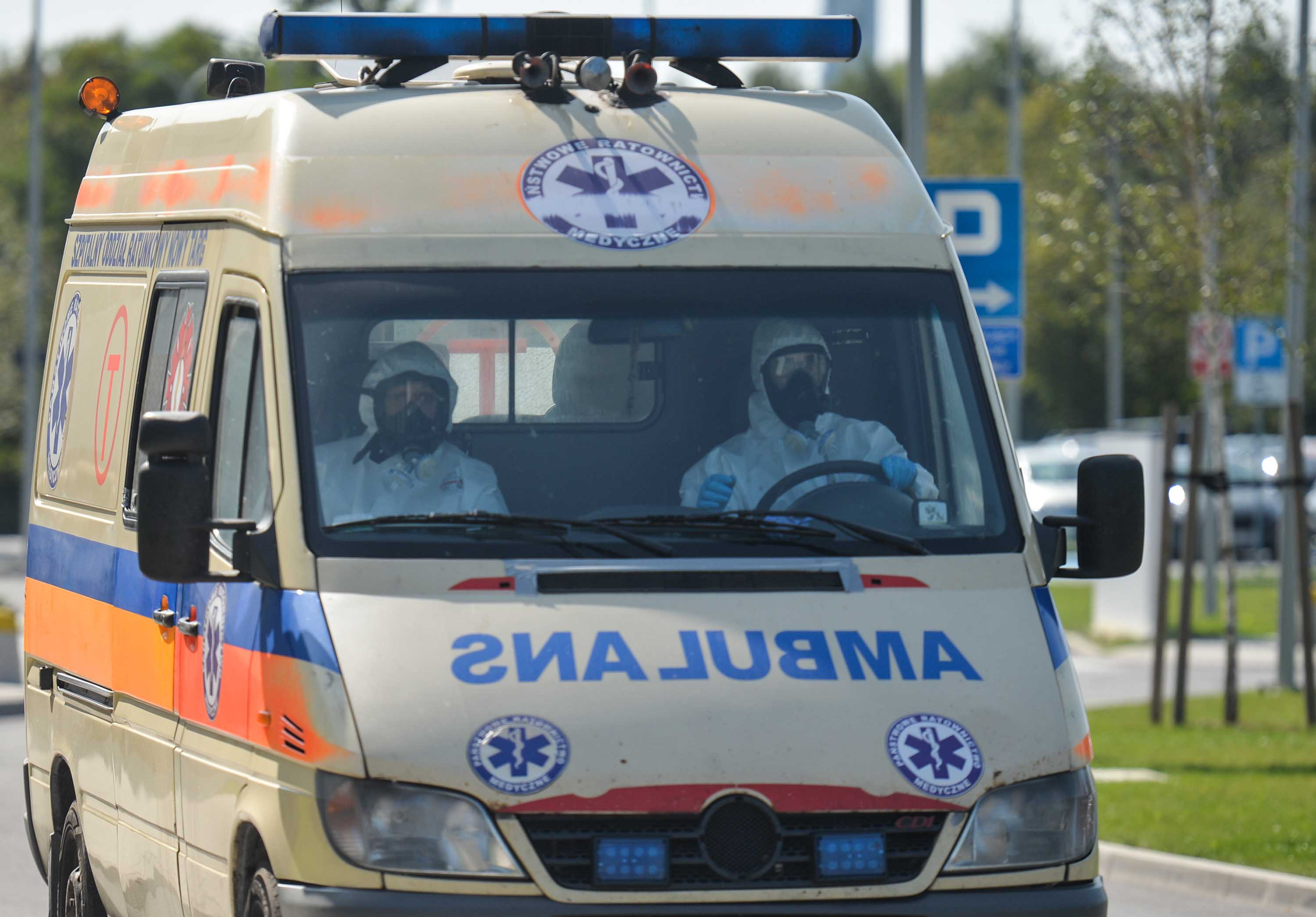 Ambulance medics wearing protective suits are seen in Krakow, Poland on September 21.