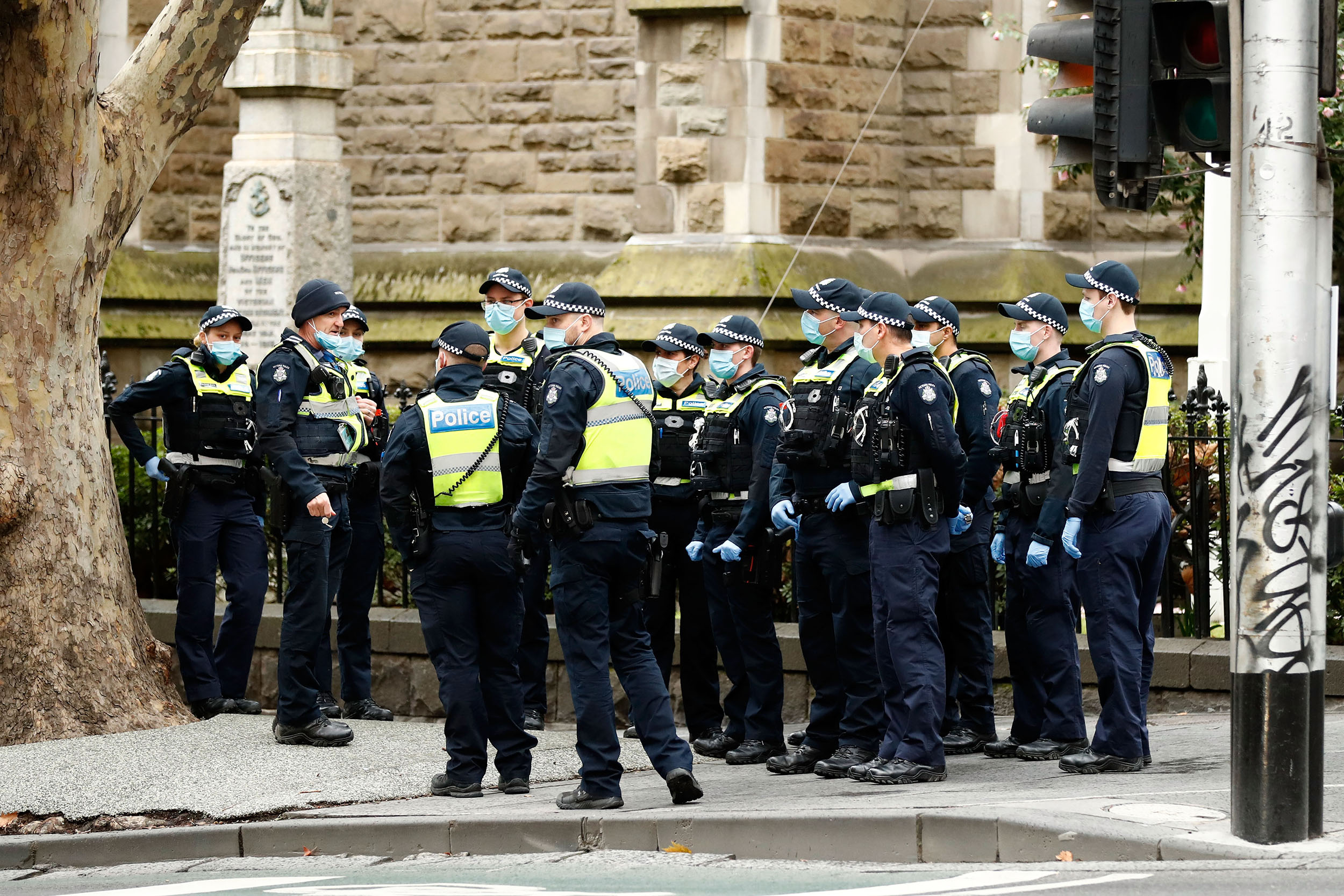 Victoria Police are seen on Wednesday August 5 in Melbourne, Australia, before retail stores closed to customers.