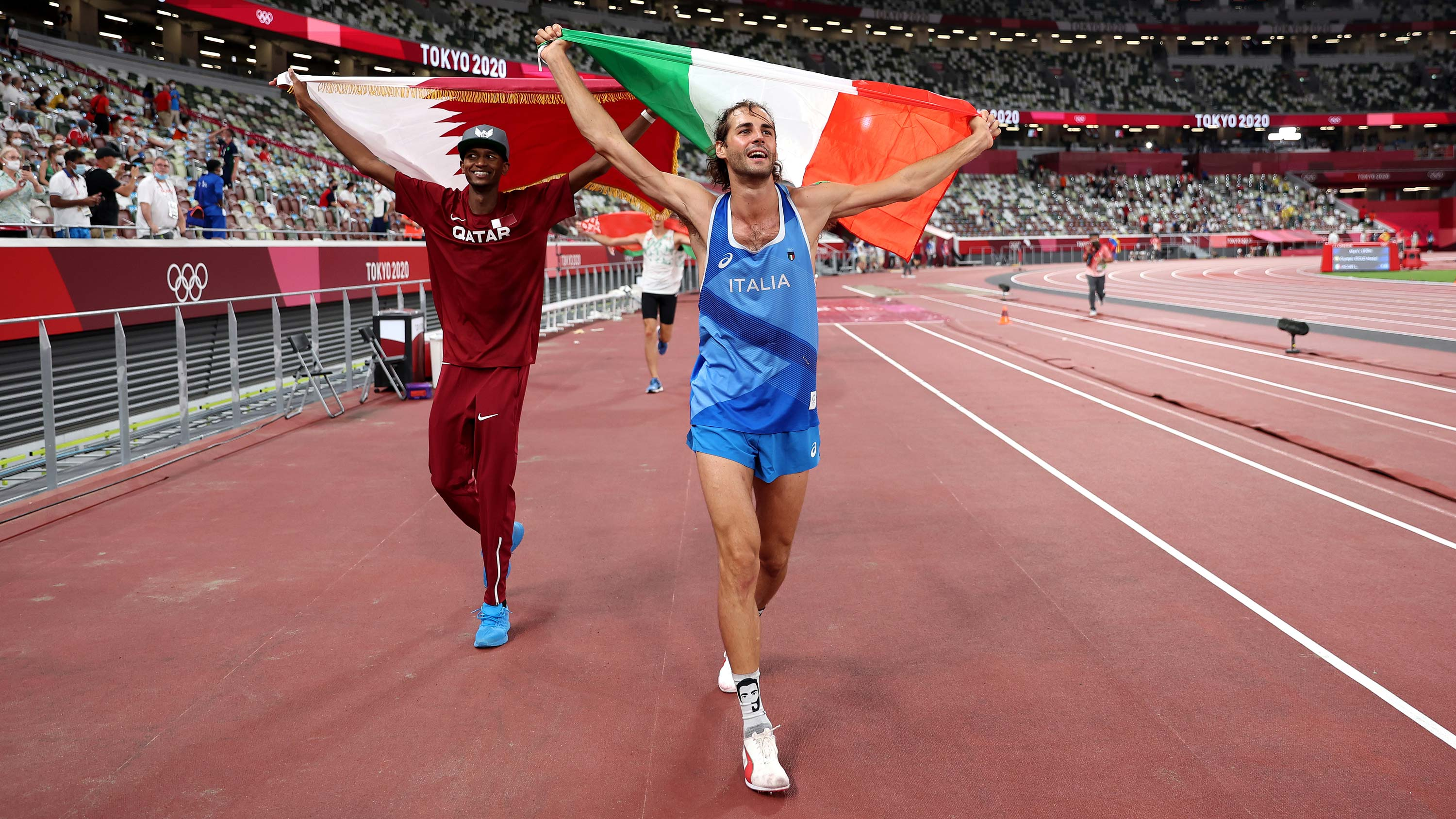 Joint gold medalists Mutaz Essa Barshim of Qatar and Gianmarco Tamberi of Italy celebrate on the track following the high jump final at the Olympic Stadium on August 1.