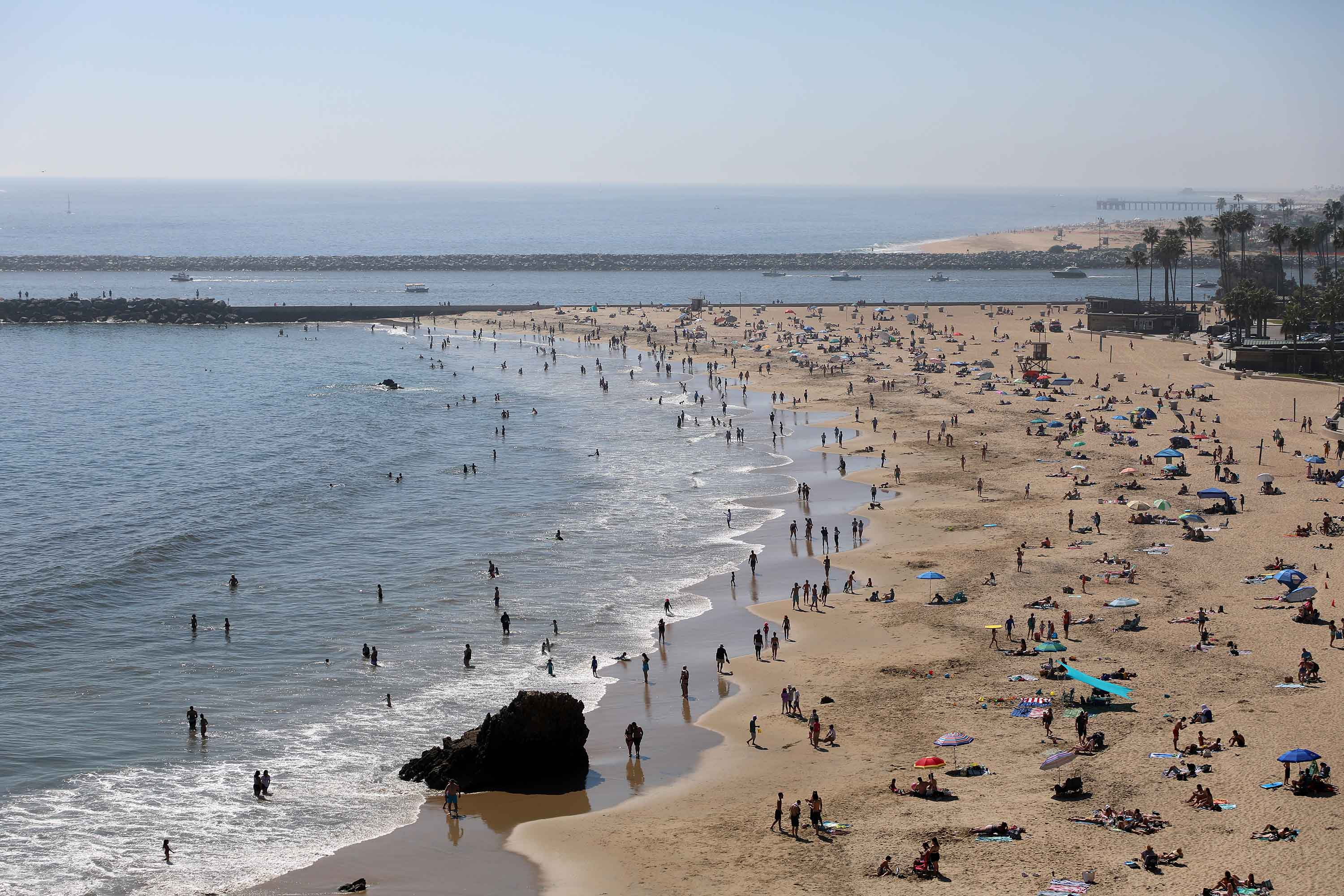 People are seen gathering on the Corona del Mar State Beach in Newport Beach, California on April 25.