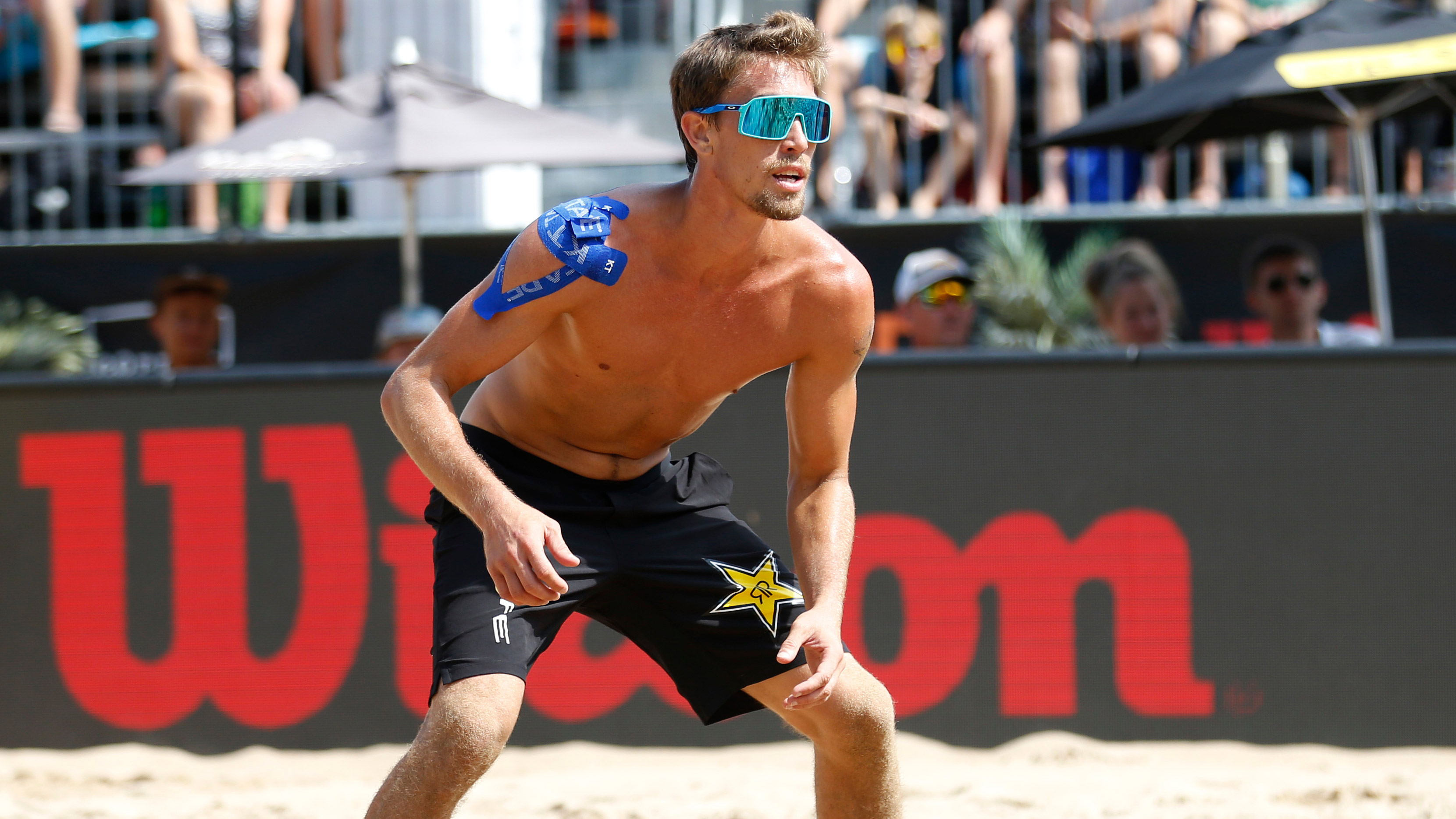 Taylor Crabb stands on the court during the AVP Gold Series Championships at Oak Street Beach on September 1, 2019, in Chicago.
