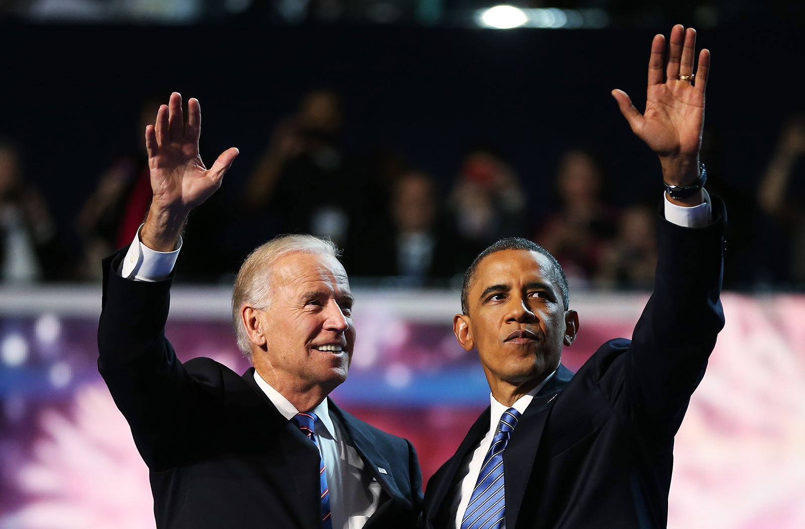 Former President Barack Obama and Vice President Joe Biden wave after accepting the nomination during the final day of the Democratic National Convention at Time Warner Cable Arena on September 6, 2012 in Charlotte, North Carolina.