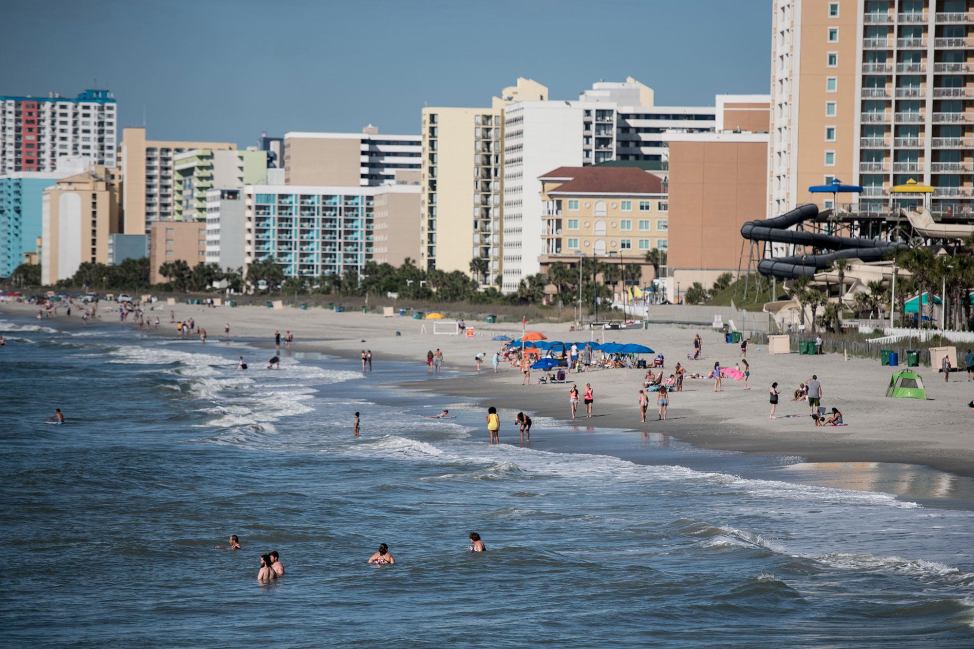 People wade in the surf on the morning of May 23 in Myrtle Beach, South Carolina.