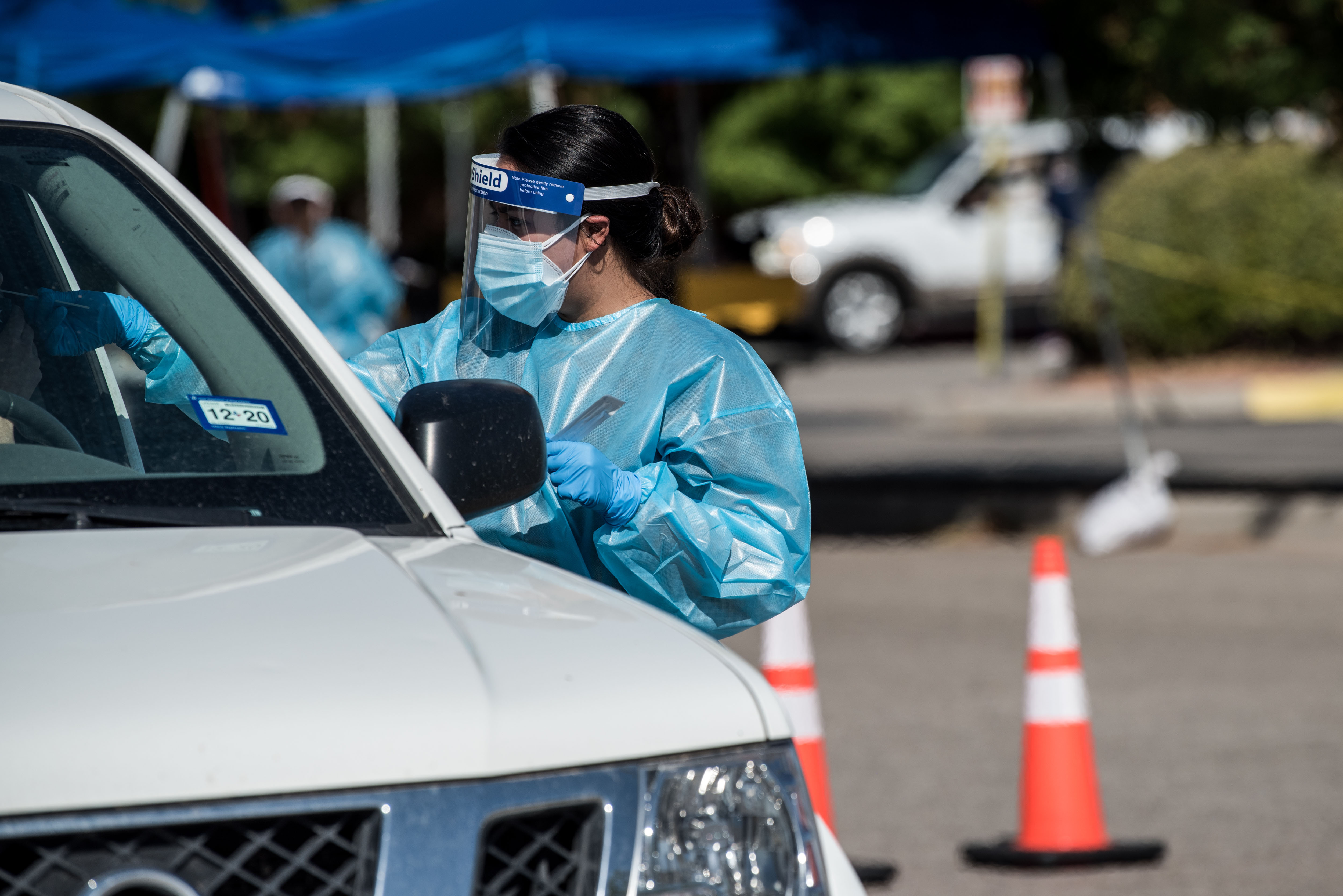 A nurse conducts a coronavirus test in El Paso, Texas, on July 21.
