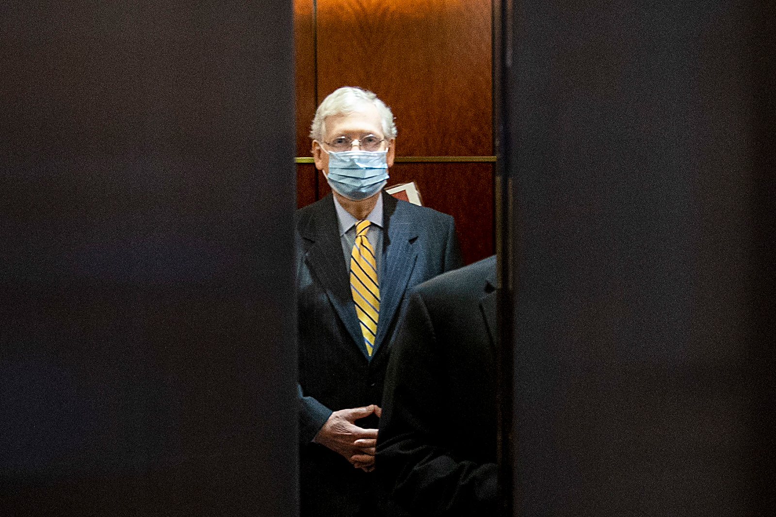 Senate Majority Leader Mitch McConnell (R-KY) leaves after a closed door briefing at the US Capitol on July 2 in Washington.