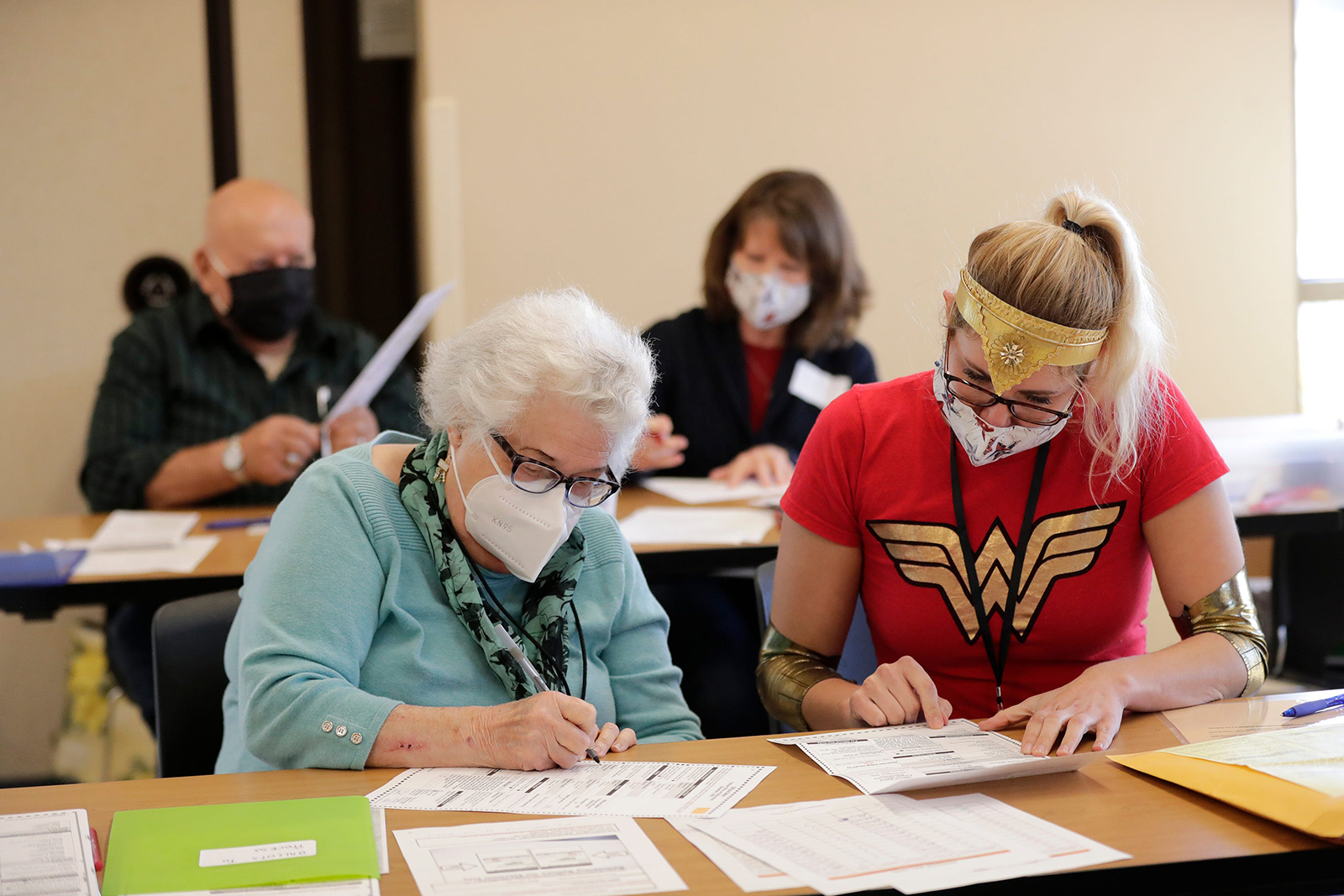 Jackie Lemberger, left, and Maureen Armstrong redo ballots that had a printer error at the Town Center Park on Tuesday, November 3, in Grand Chute, Outagamie County, Wisconsin.