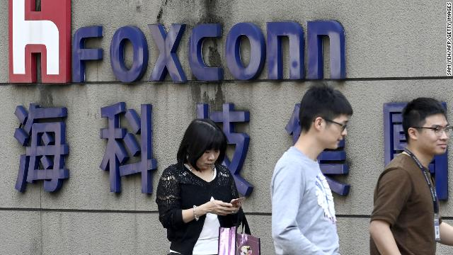 People walking past a Foxconn sign in Taipei in January 2019.