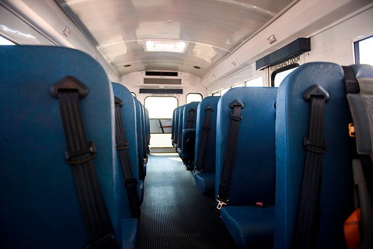 Seat belts inside an electric school bus parked at a mass vaccination site in a parking lot at Hollywood Park adjacent to SoFi stadium during the Covid-19 pandemic on March 1, 2021 in Inglewood, California.