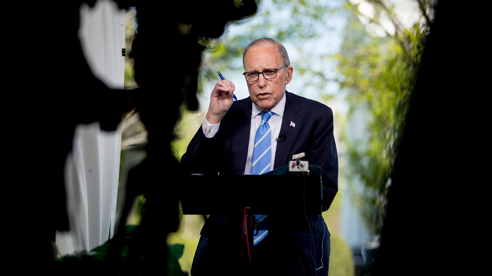 White House chief economic adviser Larry Kudlow speaks during a television interview along Pebble Beach on the North Lawn of the White House on April 9.
