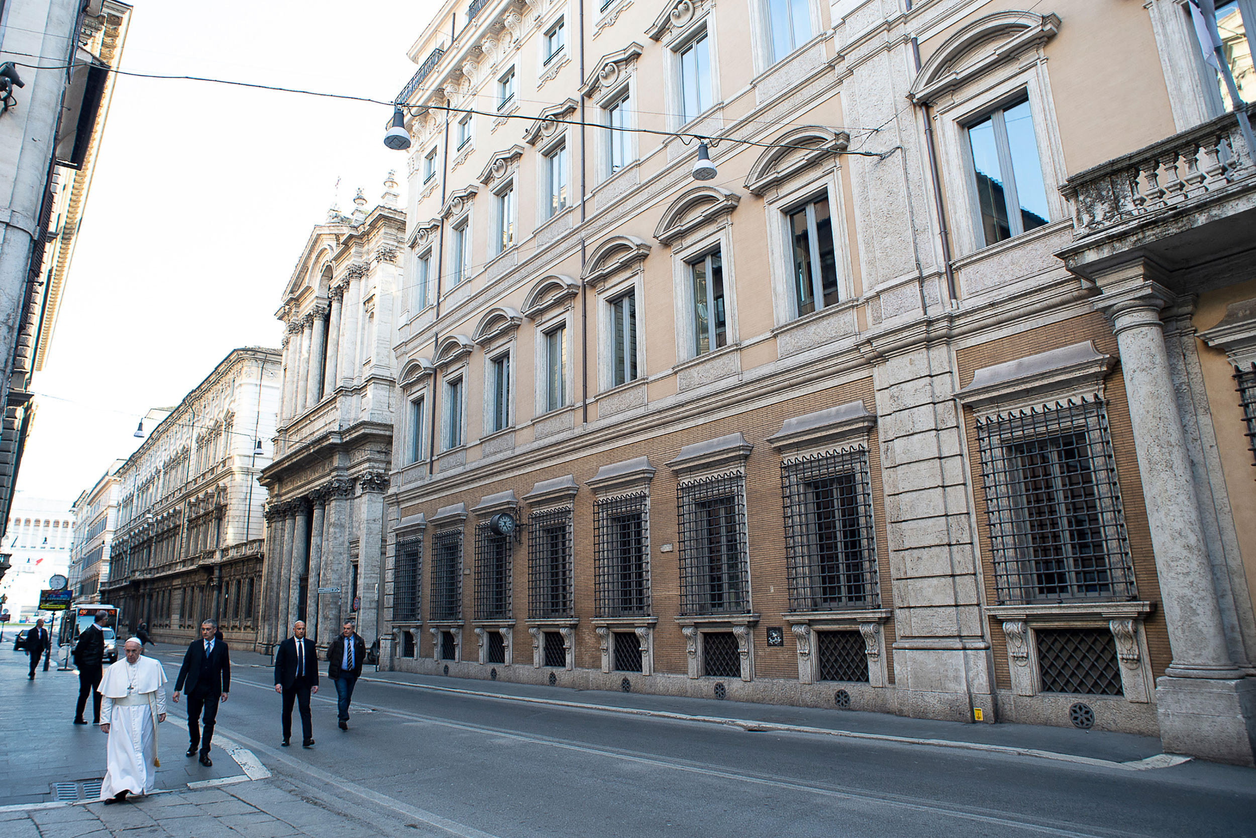 Pope Francis walks down an empty street in the Rome on March 15.