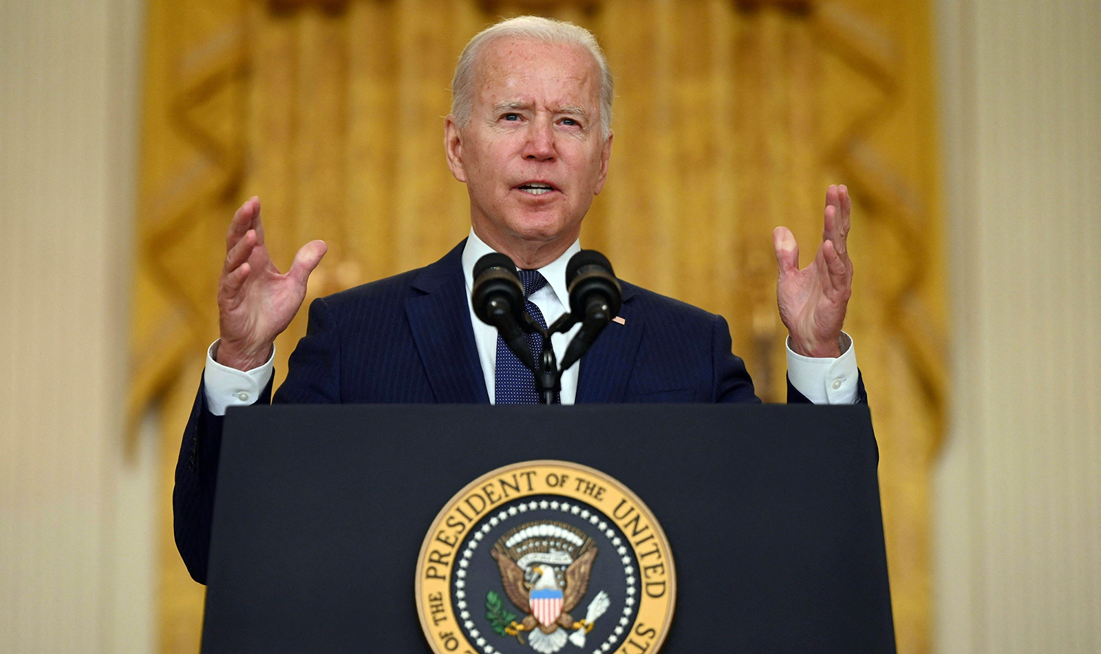 President Joe Biden delivers remarks on the terror attack at Hamid Karzai International Airport, and the US service members and Afghan victims killed and wounded, in the East Room of the White House in Washington on August 26.