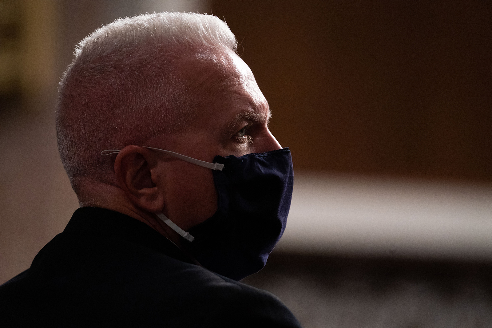 Adm. Brett Giroir listens during a hearing of the Senate Appropriations subcommittee reviewing coronavirus response efforts on Wednesday in Washington.
