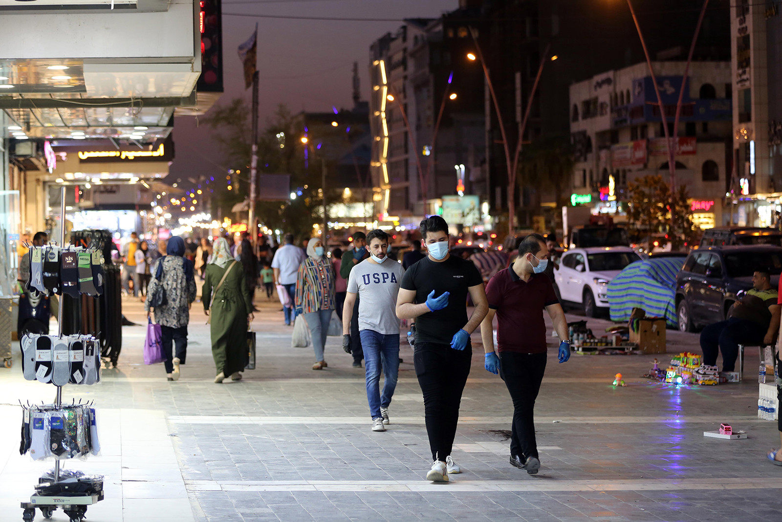 People walk on the street in Baghdad, Iraq, on August 12.
