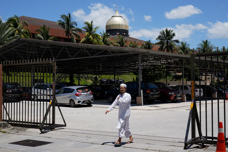 A man walks out from Seri Petaling Mosque in Kuala Lumpur, Malaysia, on Monday, March 16.
