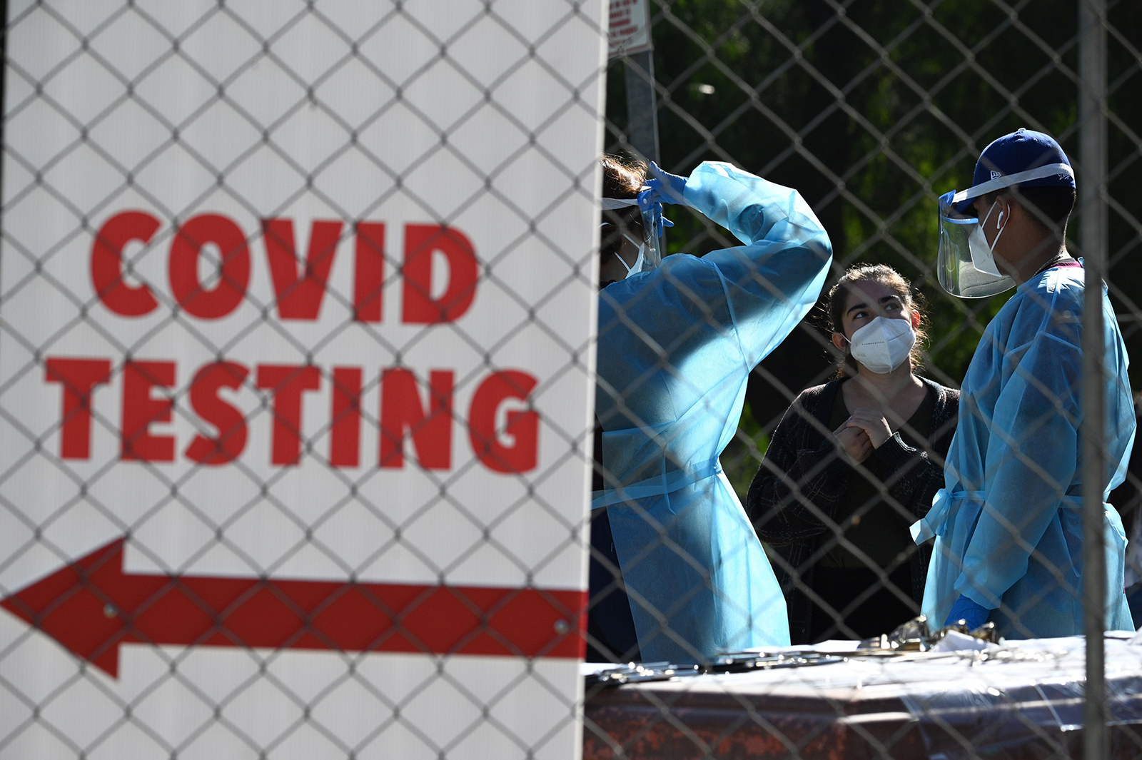 Healthcare workers are seen at a walk-up Covid-19 testing site, November 24, in San Fernando, California.
