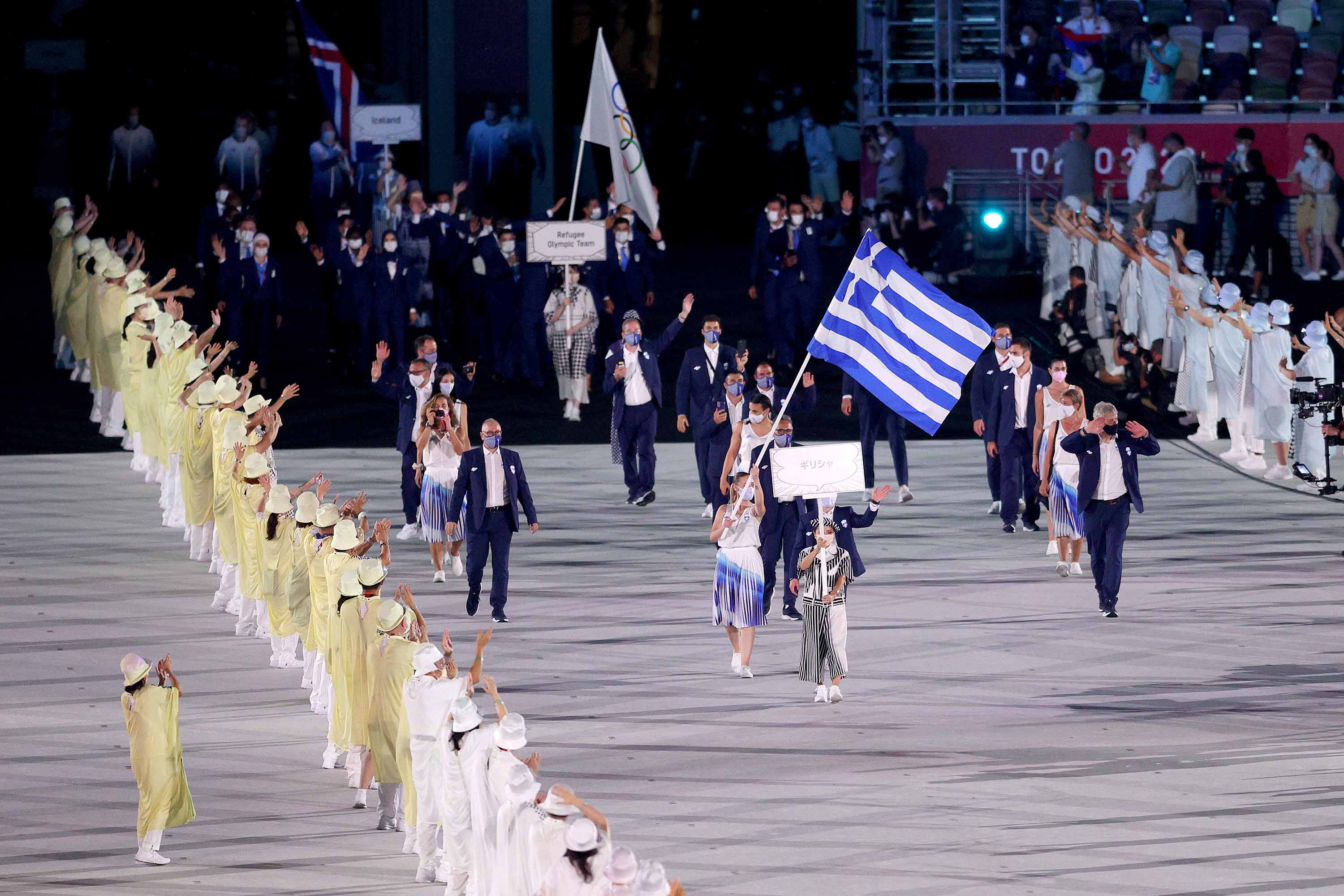 Flag bearers Anna Korakaki and Eleftherios Petrounias of Team Greece lead their teammates out during the Opening Ceremony.