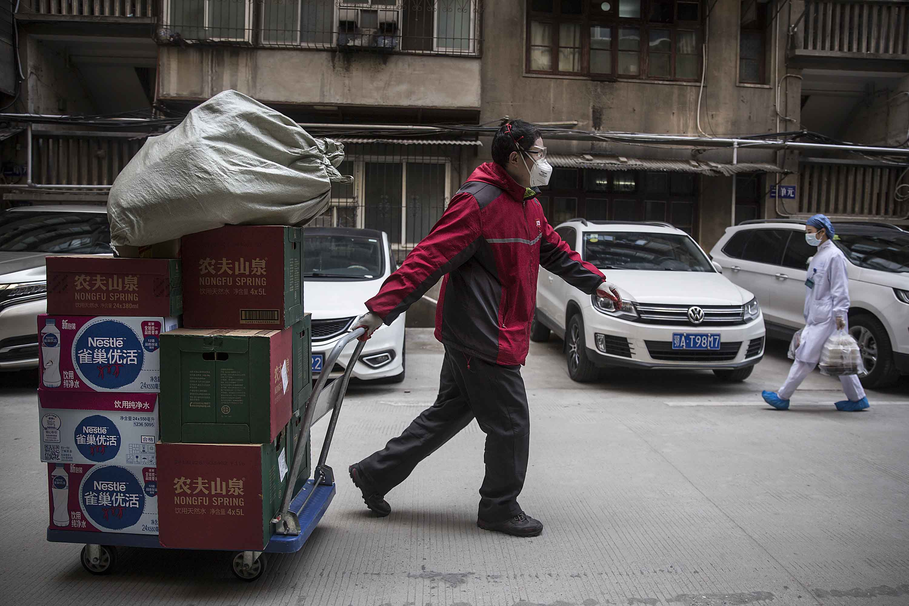 A courier delivers a shipment to Wuhan Union Hospital on January 29