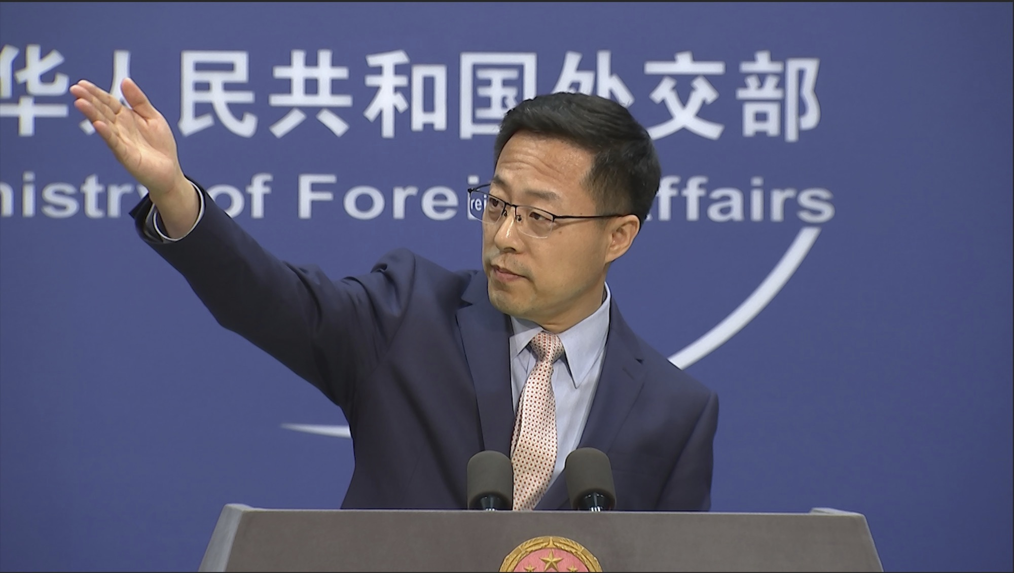 China's Ministry of Foreign Affairs spokesman Zhao Lijian gestures during a press briefing in Beijing on Monday, November 23.